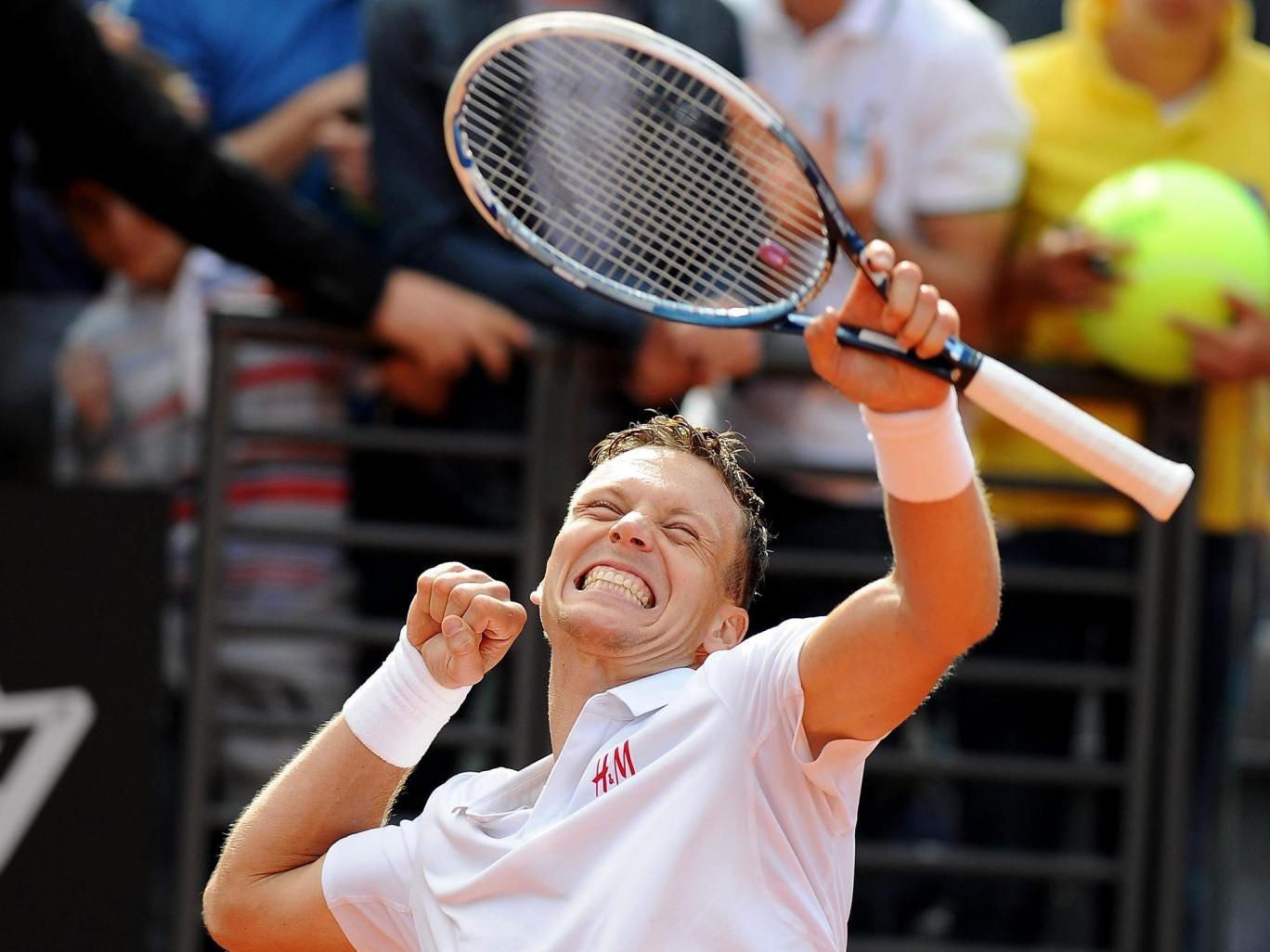 Thomas Berdych celebrates after beating Novak Djokovic