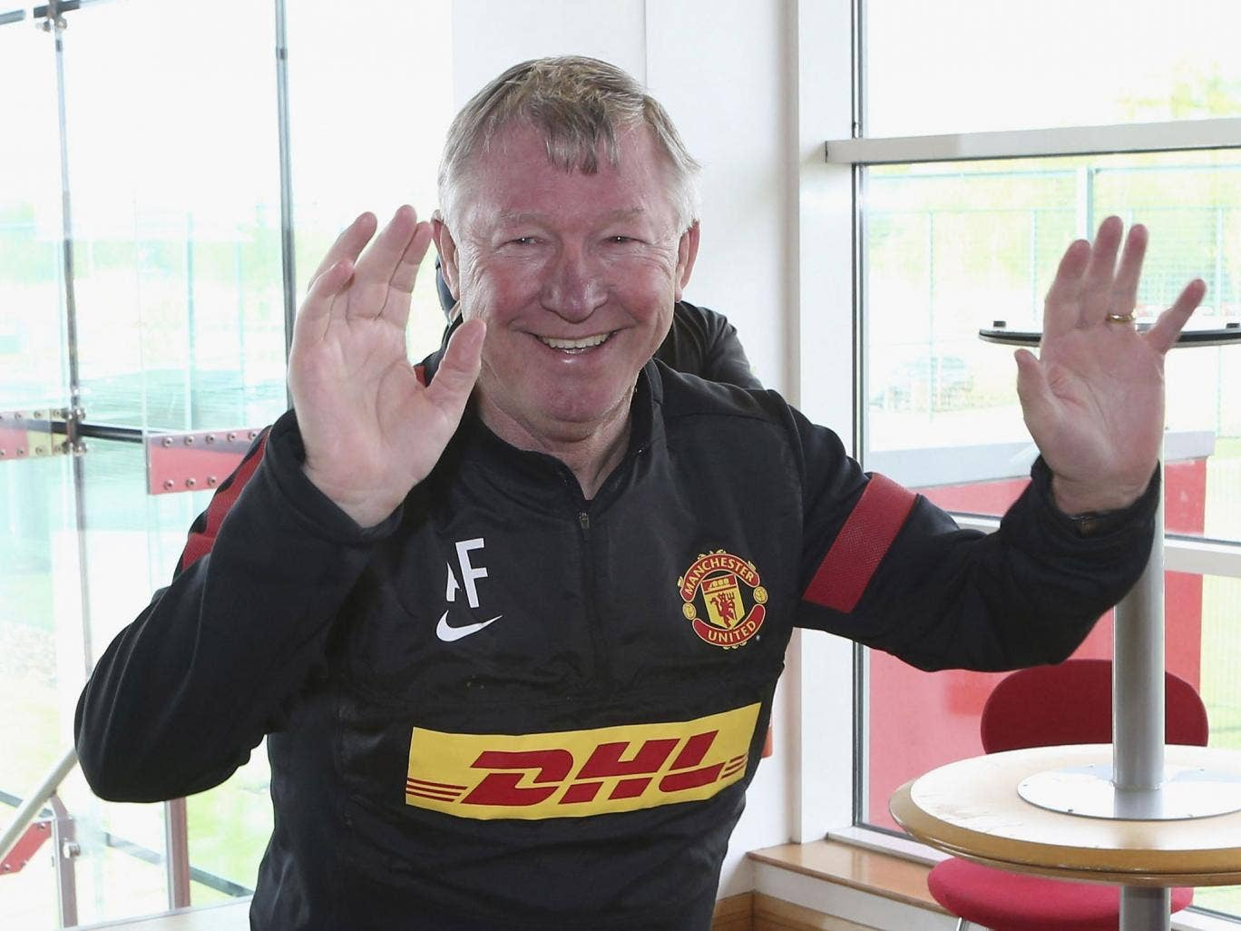 Sir Alex Ferguson in his sponsored United training top at his last Friday press conference
