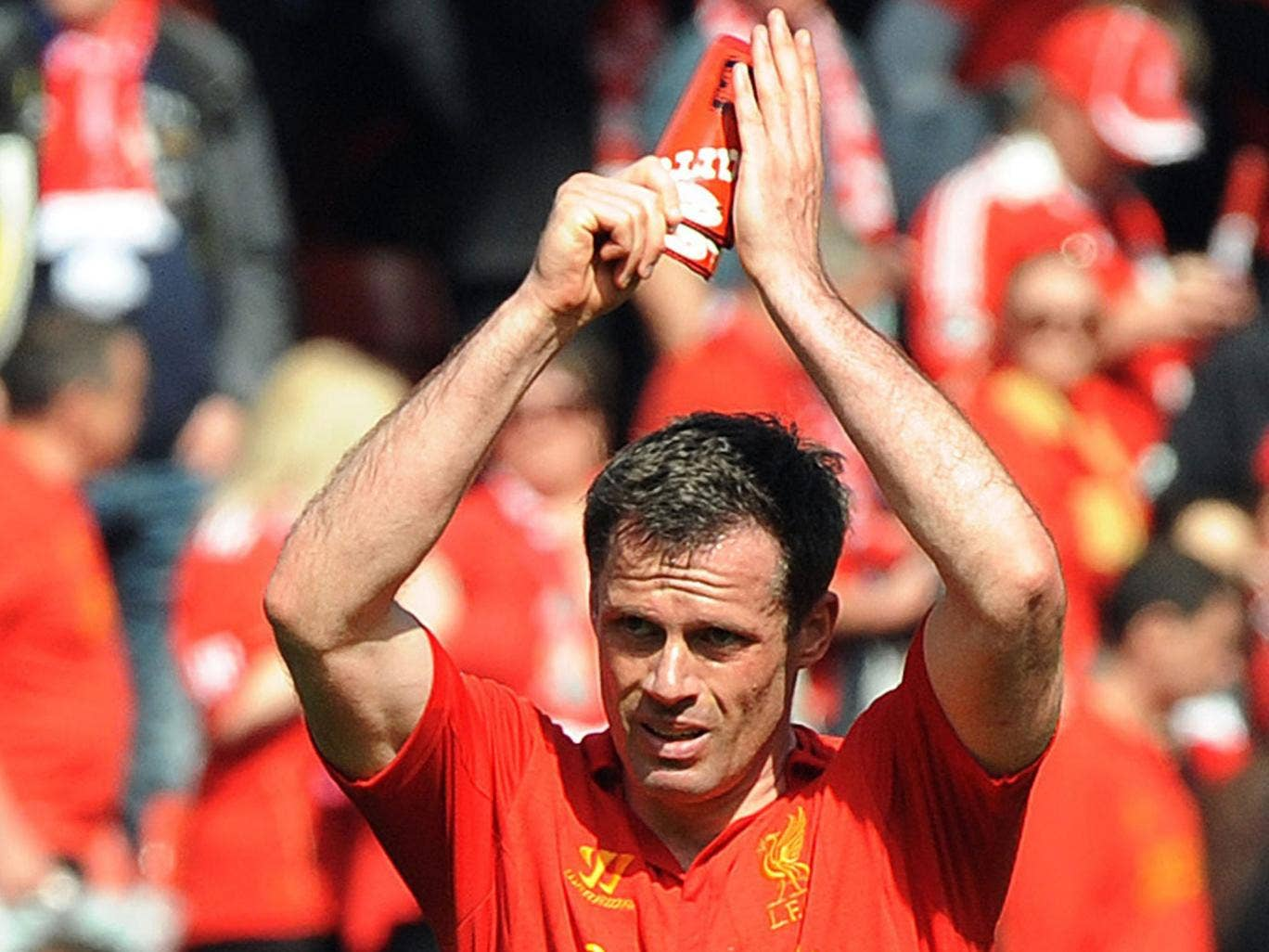 Liverpool's Jamie Carragher applauds at the end of the English Premier League match between Liverpool and Everton at Anfield