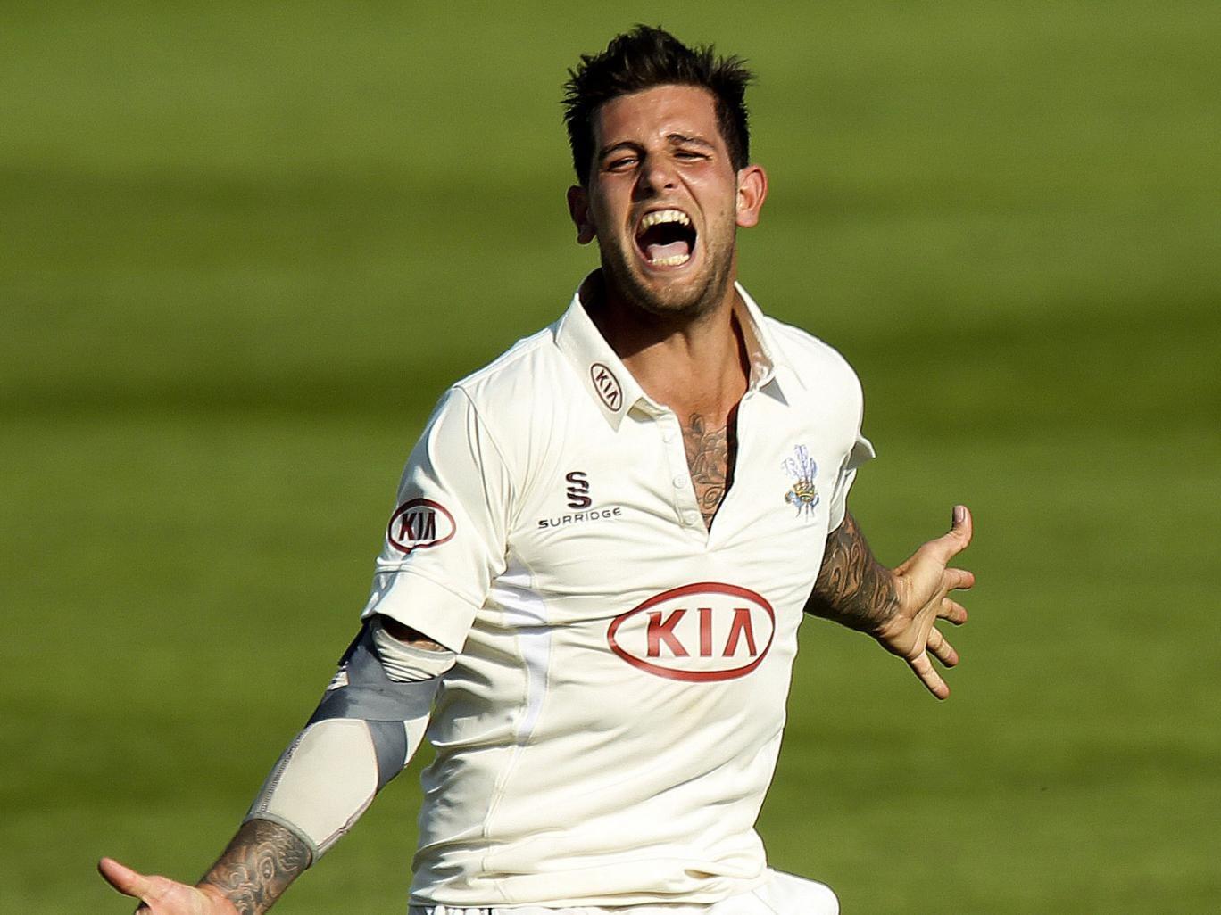Jade Dernbach took three wickets but Surrey spilt four catches