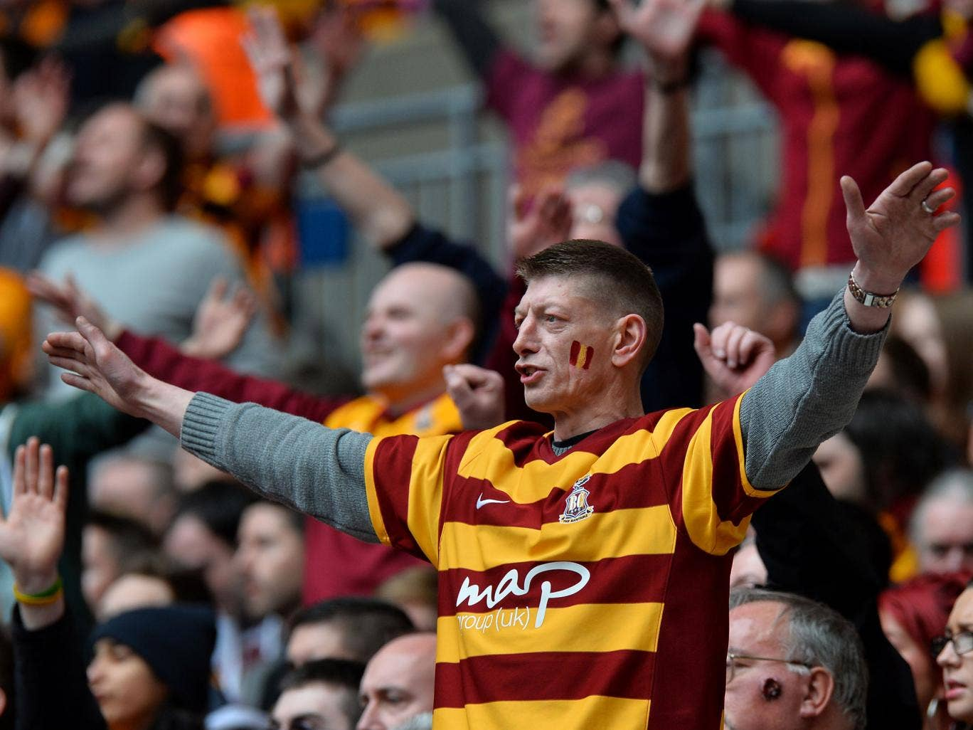 A Bradford fan watches as his team goes on to get promoted