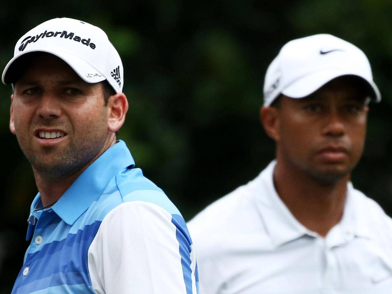 Sergio Garcia, left, and Tiger Woods, right, have clashed over the years