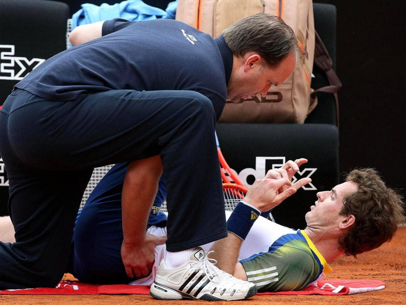 Andy Murray receives treatment on his back during his game in Rome against Marcel Granollers last week