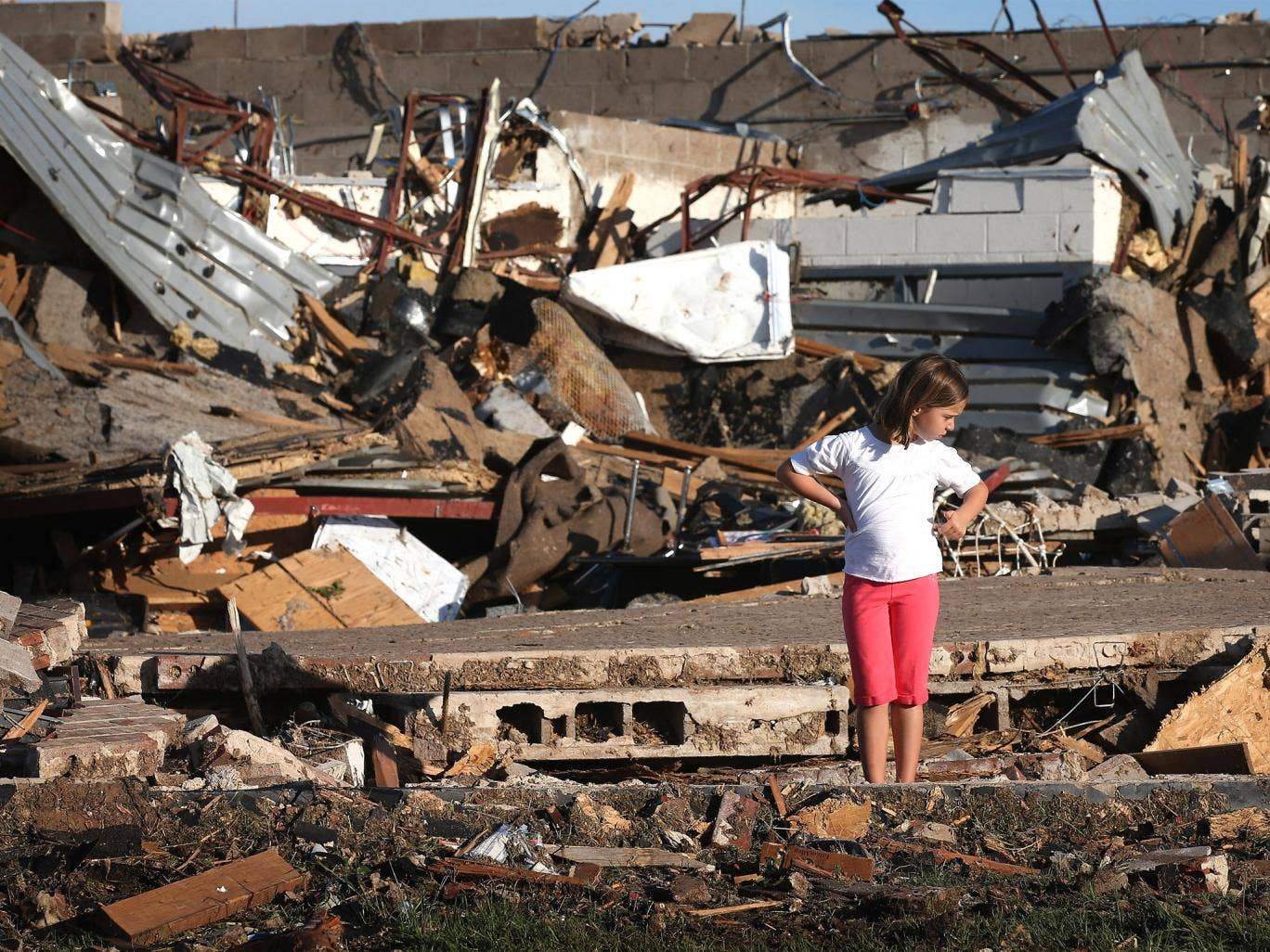 A child looks over damage at Briarwood Elementary School