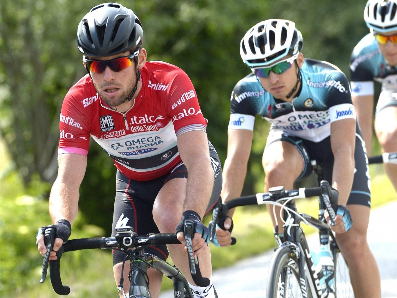 Mark Cavendish (left) tries to keep up in the points leader's red jersey yesterday