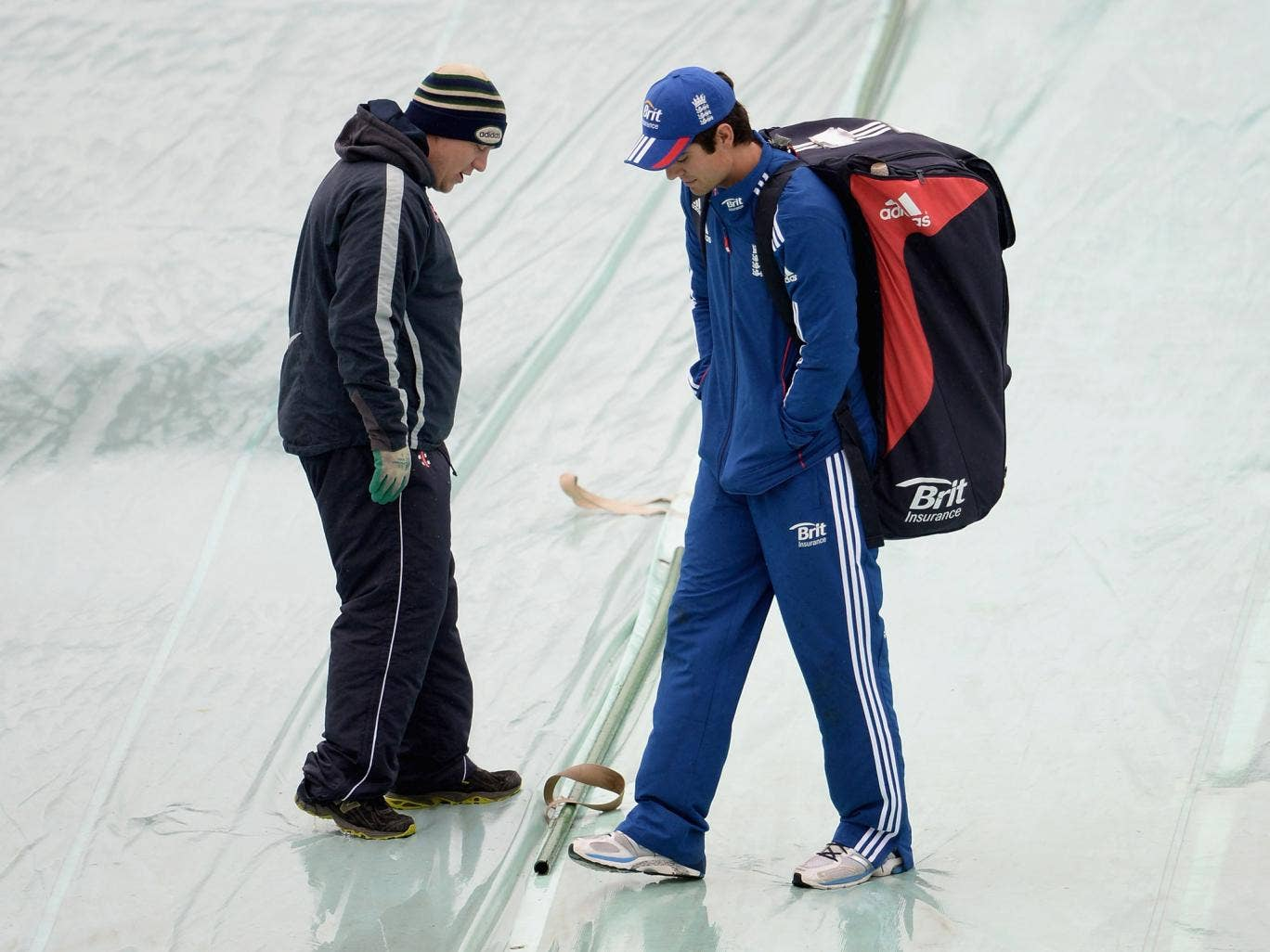 England captain Alastair Cook speaks with groundsman as rain delays play on day one of 2nd Investec Test match between England and New Zealand at Headingley