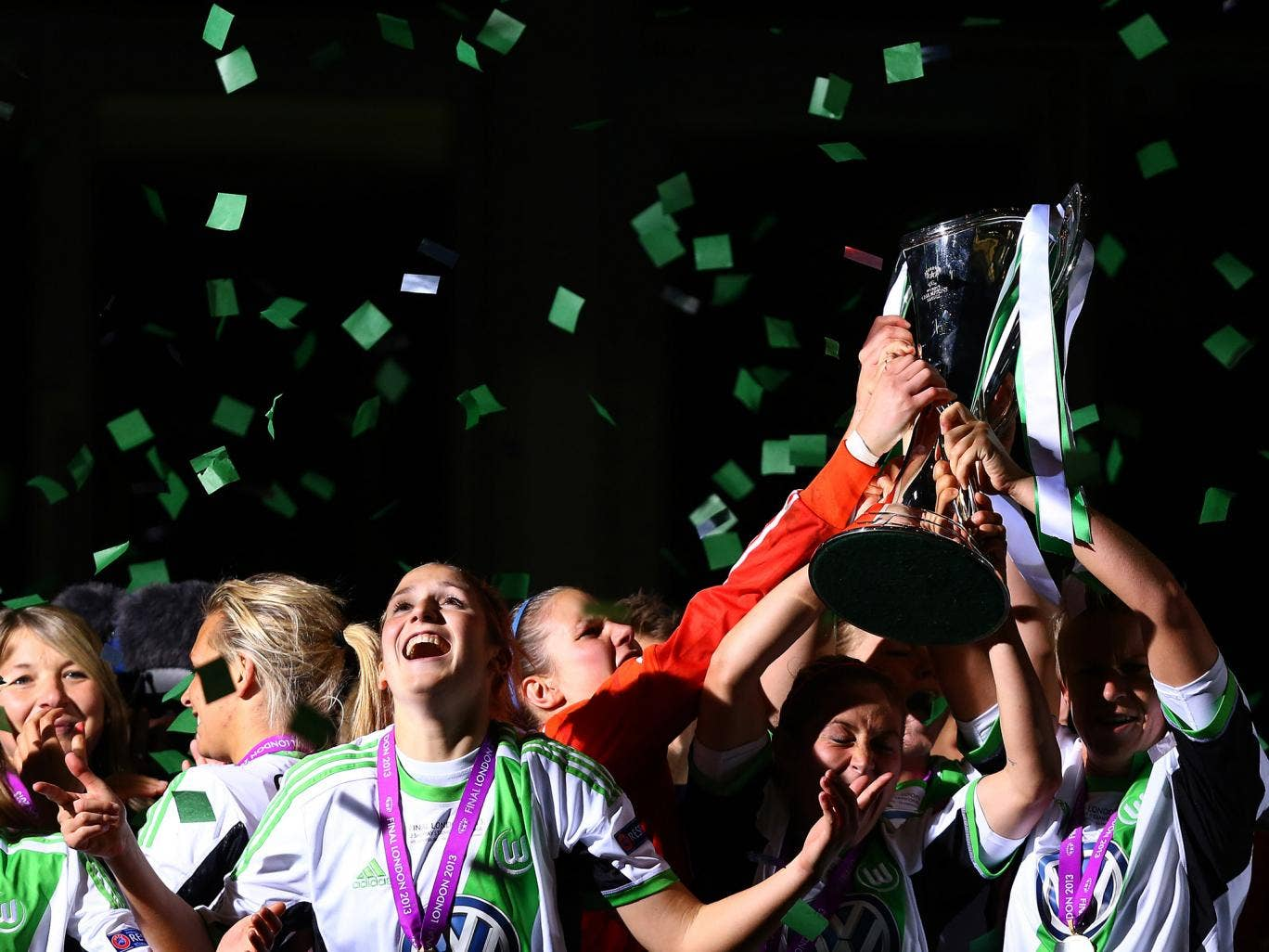 Wolfsburg players celebrate with the trophy after winning the UEFA Women's Champions League final match between VfL Wolfsburg and Olympique Lyonnais