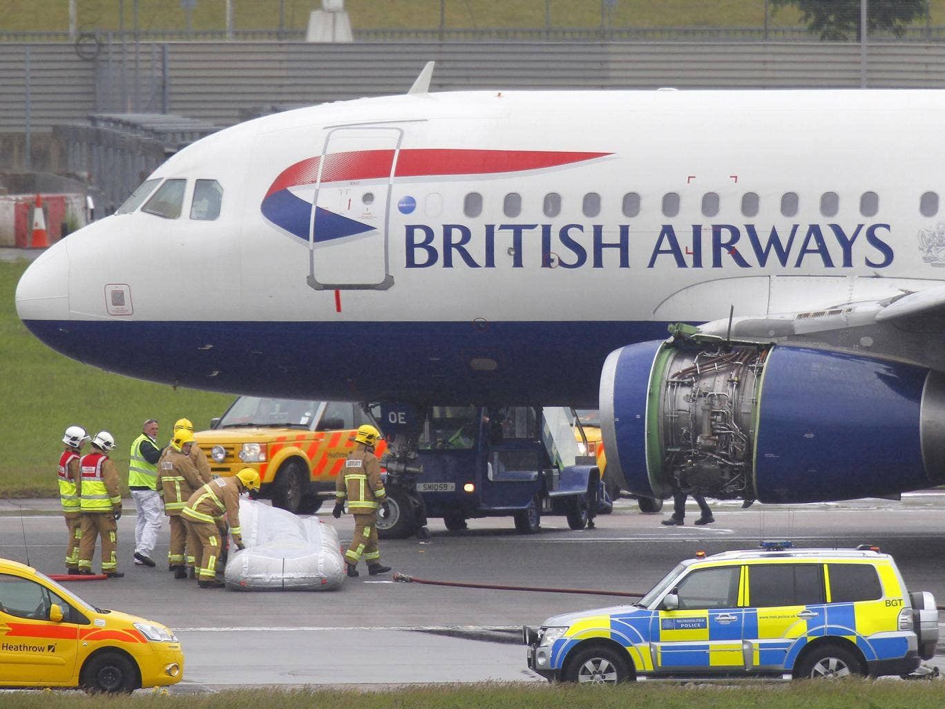 24 May 2013: Emergency services attend a British Airways passenger plane after it had to make an emergency landing at Heathrow airport