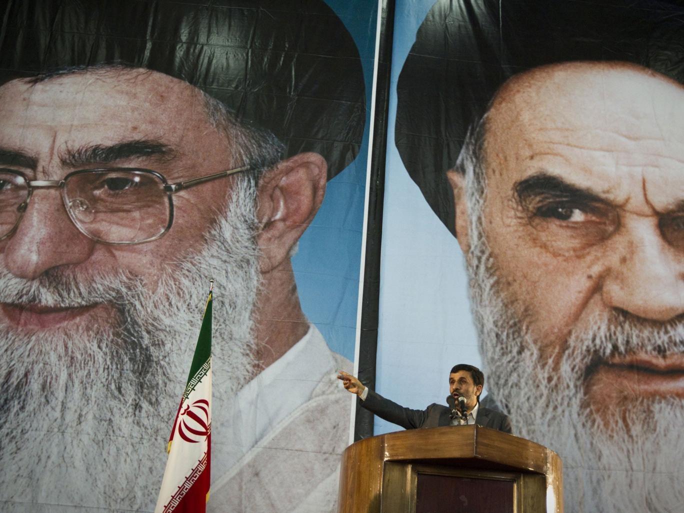 President Ahmadinejad is dwarfed by posters of  the Supreme Leader, Ayatollah Ali Khamenei, left, and Ayatollah Ruhollah Khomeini