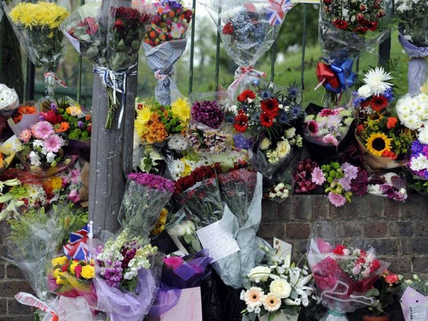 Flowers and tributes left at the site of Lee Rigby's murder in Woolwich