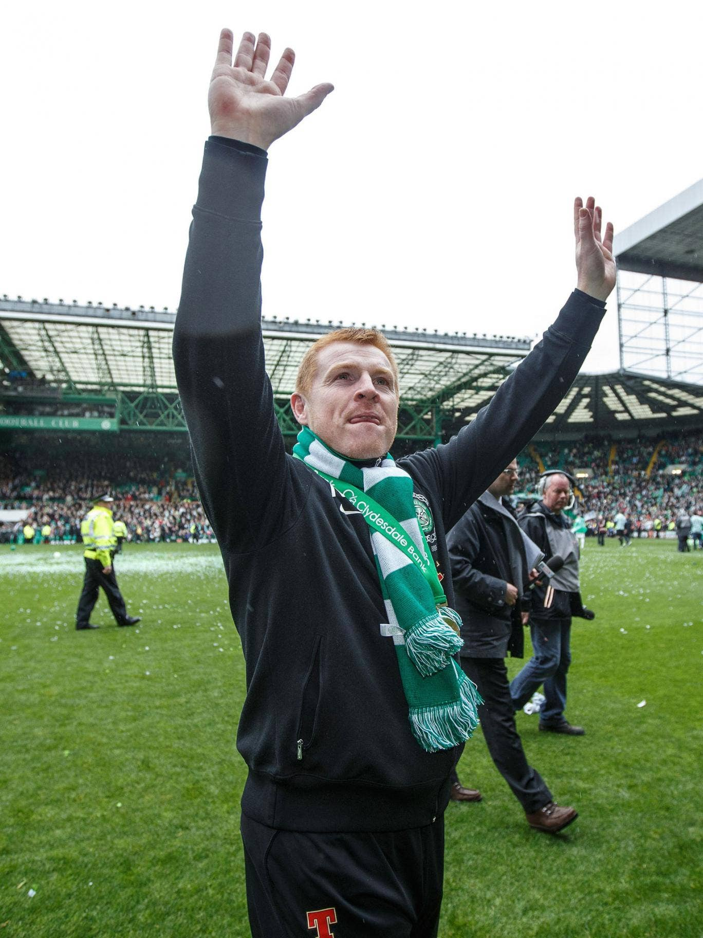Buoyant: Neil Lennon enjoys the acclaim at Celtic Park after winning the League title in a season which also saw his team beat Barcelona at the stadium