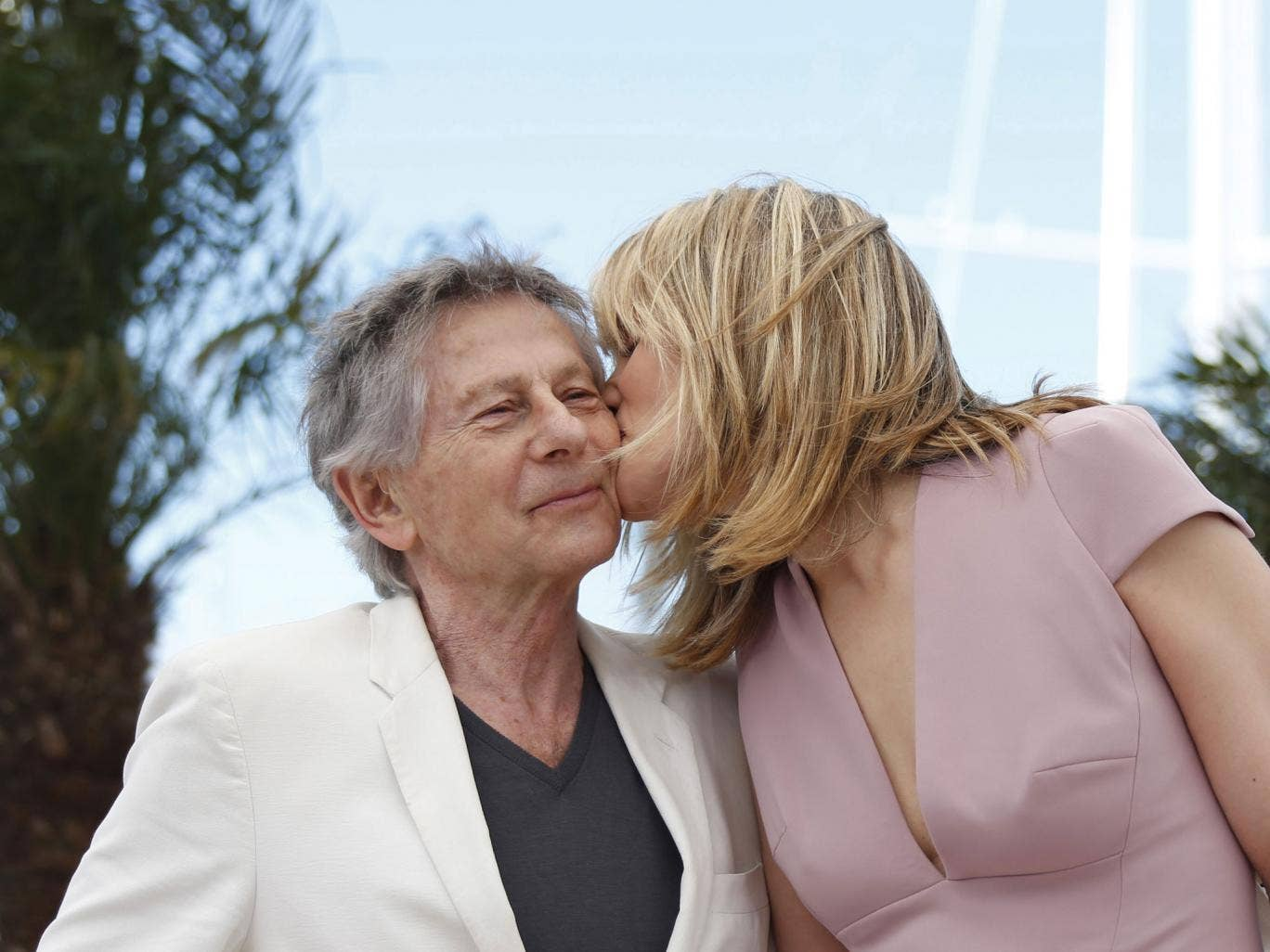 Emmanuelle Seigner and Roman Polanski kiss at the Cannes Film Festival yesterday