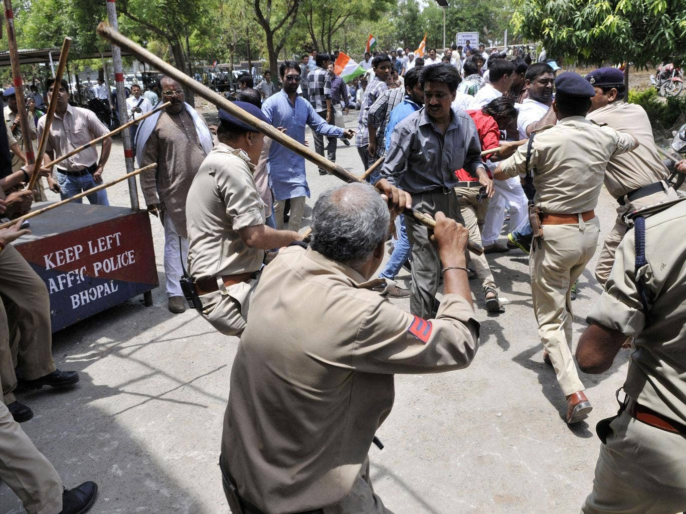 Congress party workers clash with police at a protest after the rebel attack