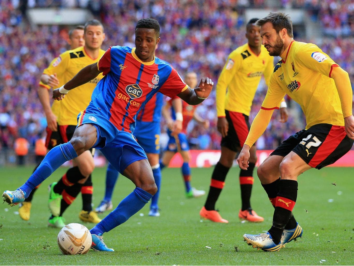 Wilfried Zaha, left, takes on Marco Cassetti, right