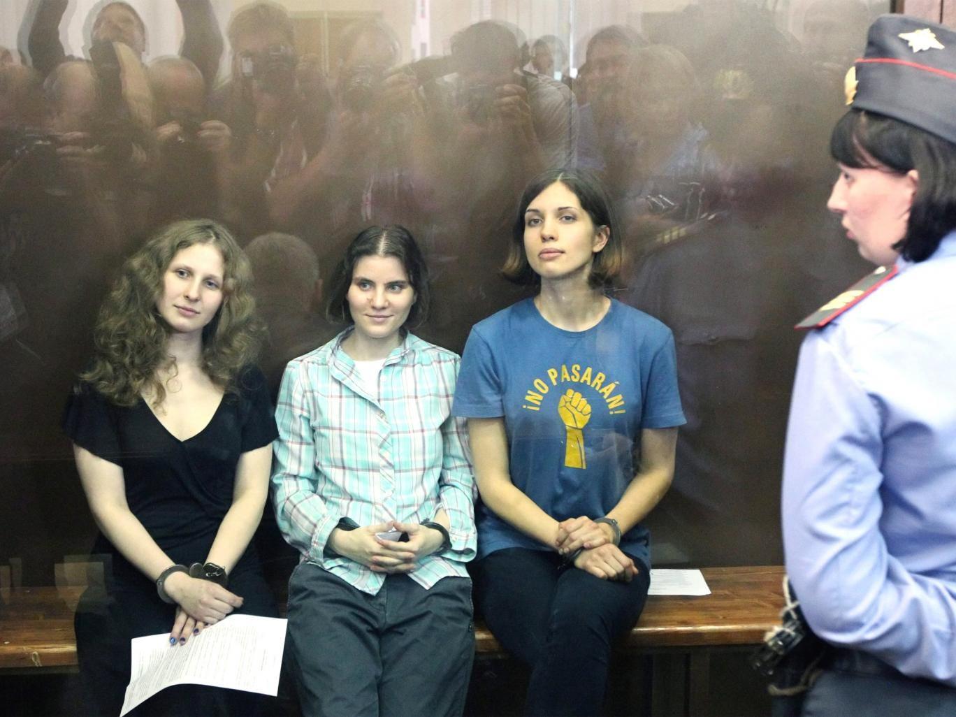 Maria Alekhina, Ekaterina Samutsevich and Nadezhda Tolokonnikova in court in 2012