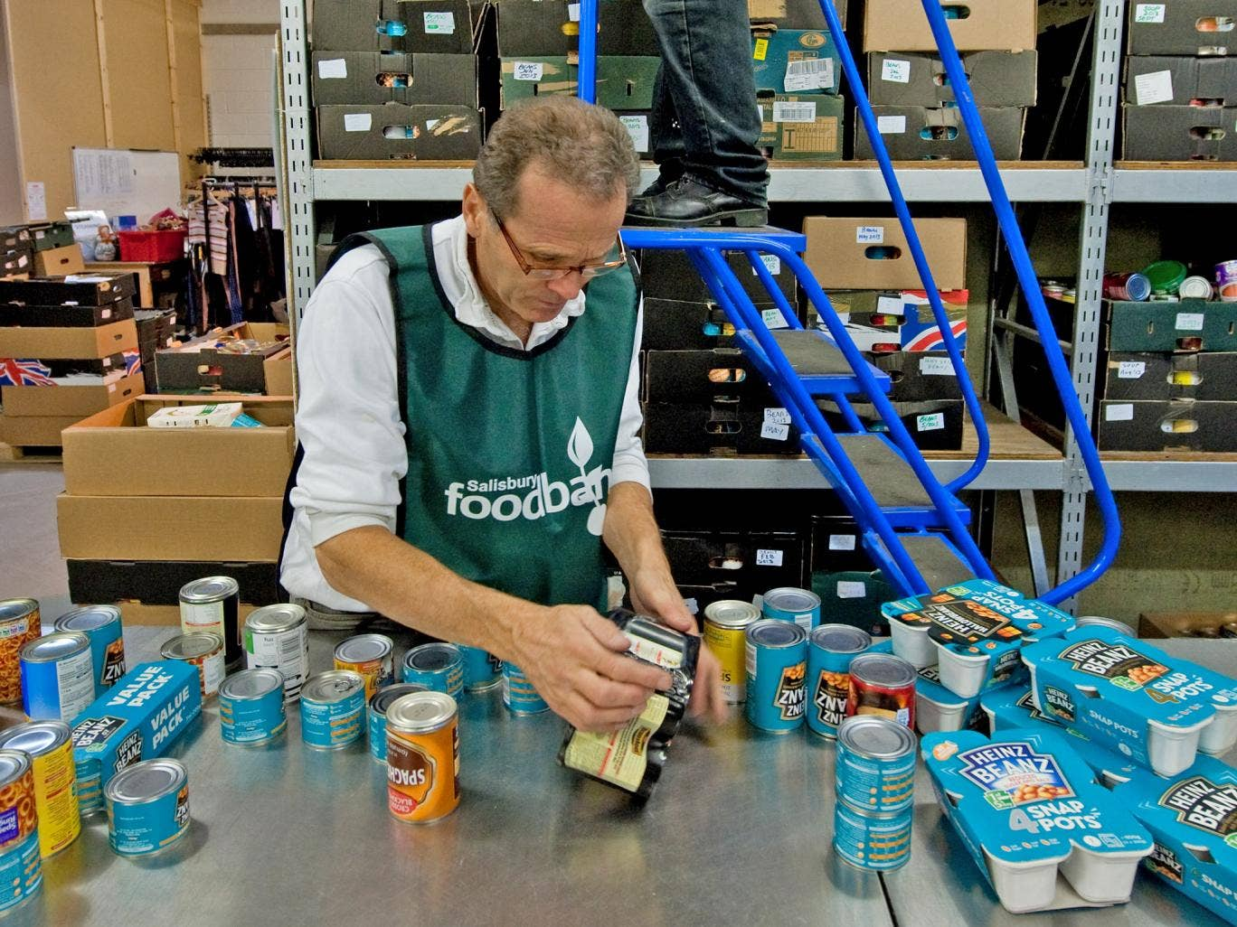 A volunteer at a Trussell Trust food bank sorts donations to the charity in Salisbury, Wiltshire