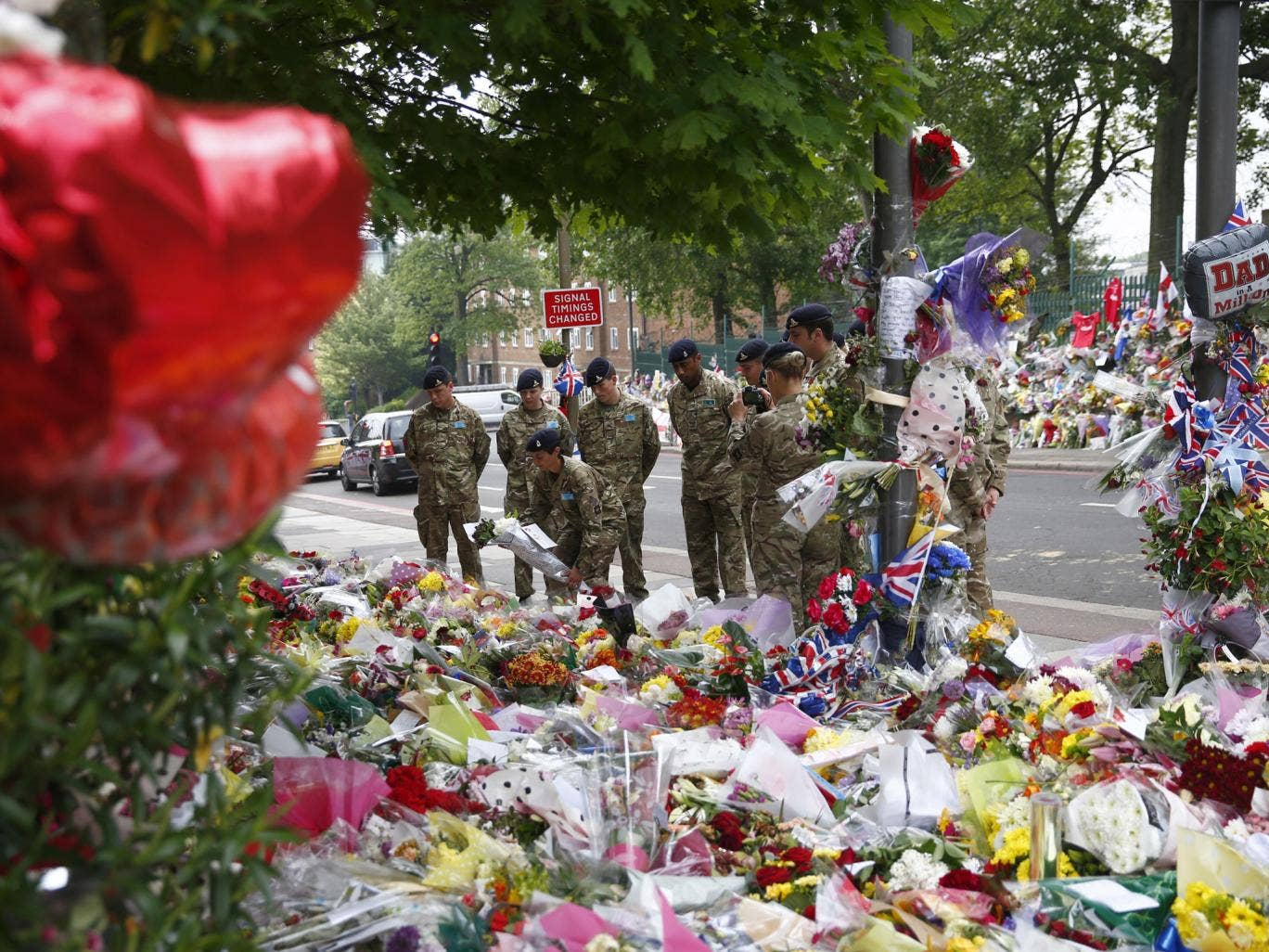 31 May 2013: Soldiers lay flowers at the scene of the killing of British soldier Lee Rigby in Woolwich, southeast London. The inquest into Rigby's death was opened and adjourned.