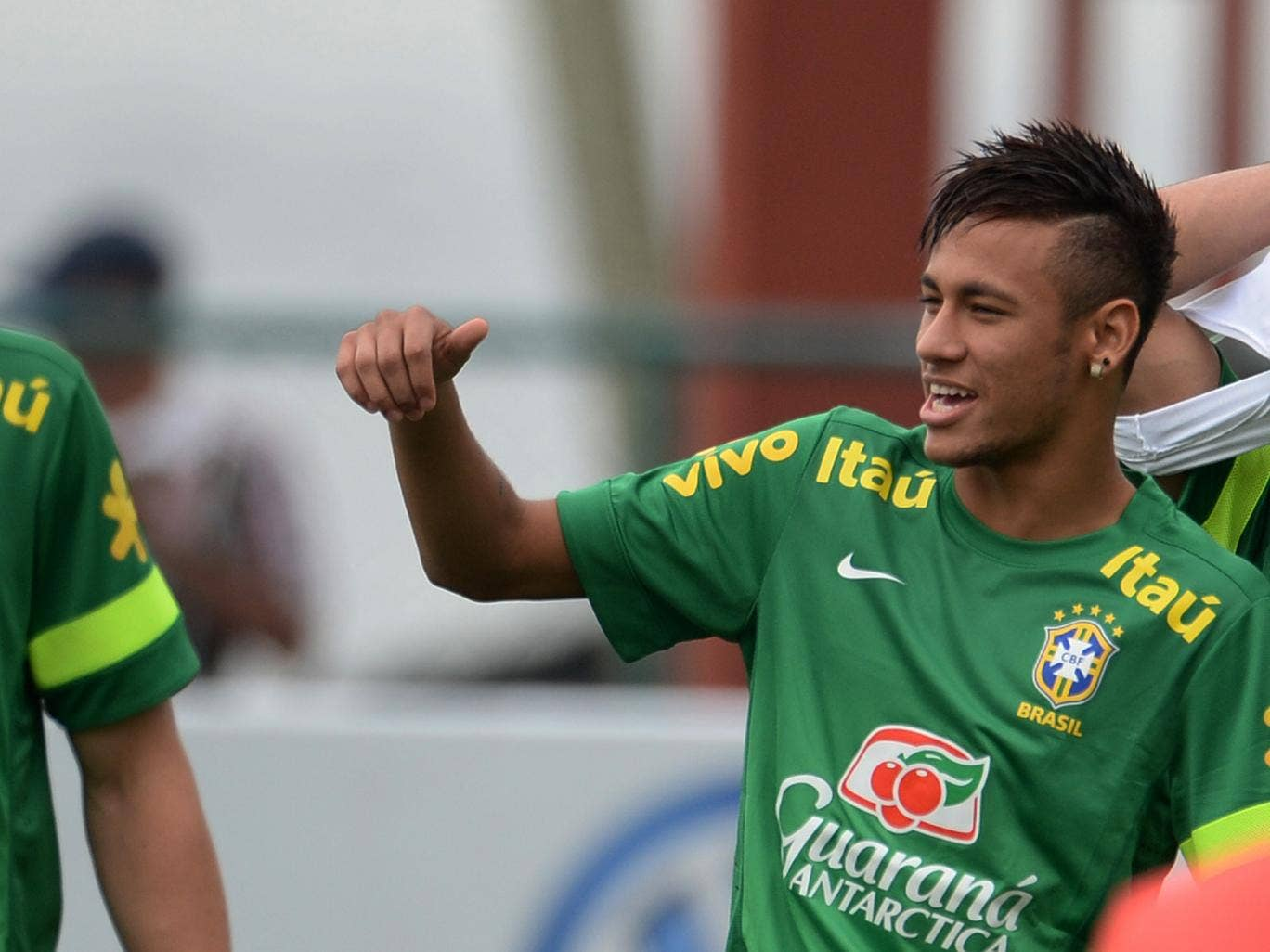 Neymar takes part in a training session with Brazil