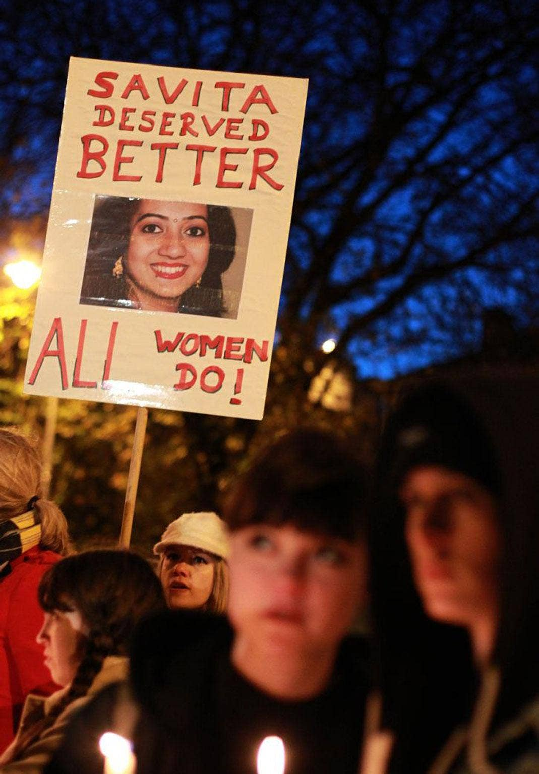 A protester outside the Irish parliament remembers Savita Halappanavar, who died after being refused an abortion