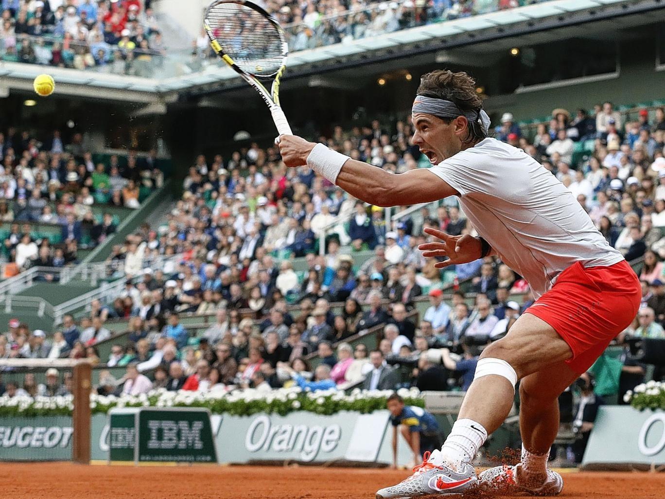 Rafael Nadal of Spain puts in a screaming return in his victory over the Italian Fabio Fognini