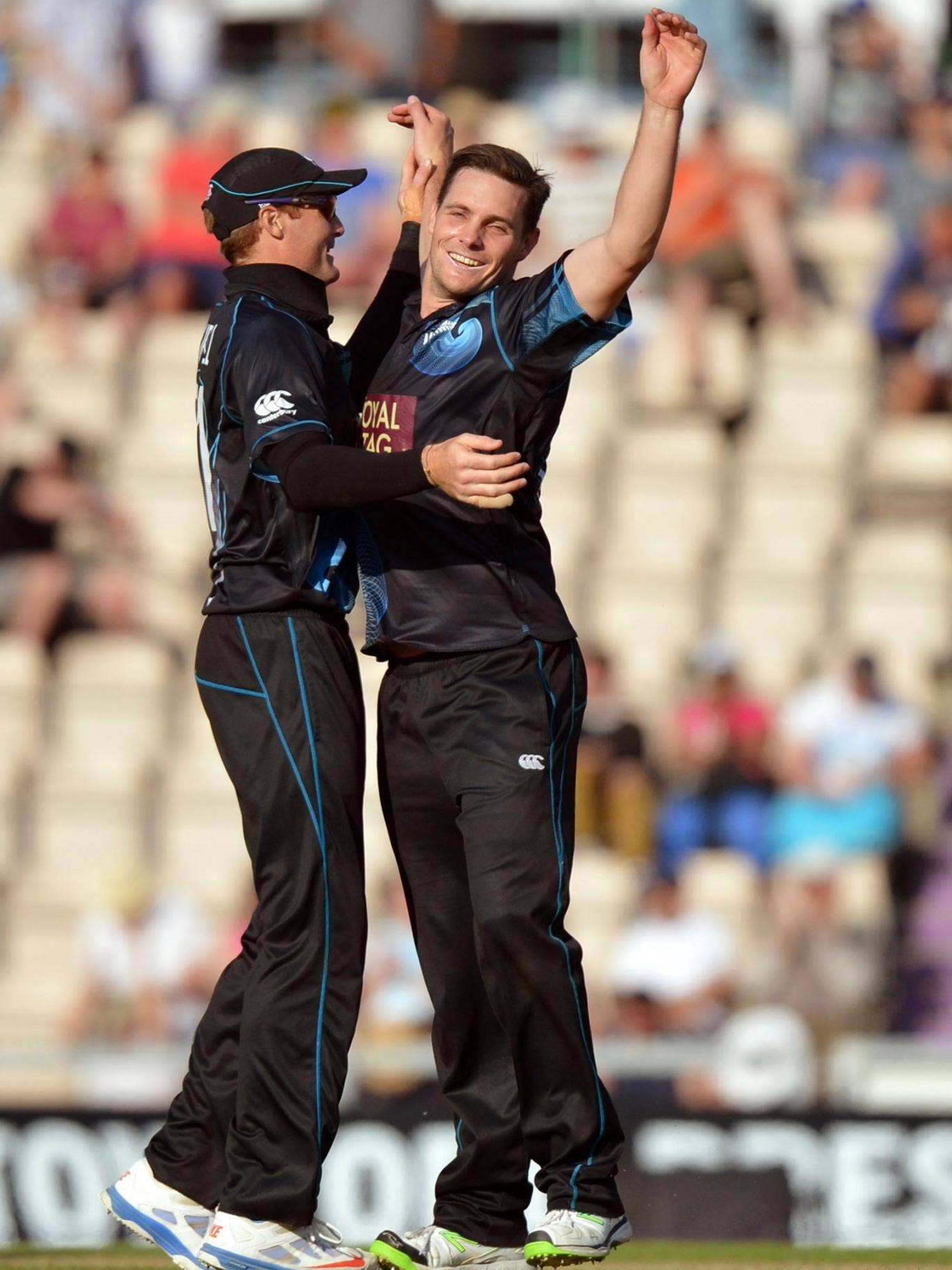 Mitchell McClenaghan, right, takes the wicket of Jade Dernbach