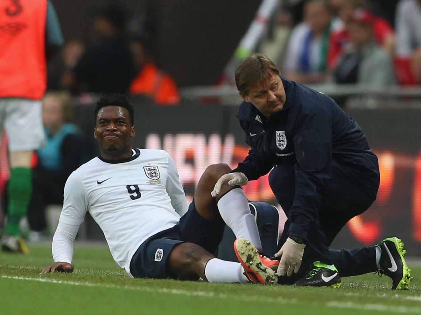 Daniel Sturridge is treated by physio Gary Lewin at Wembley
