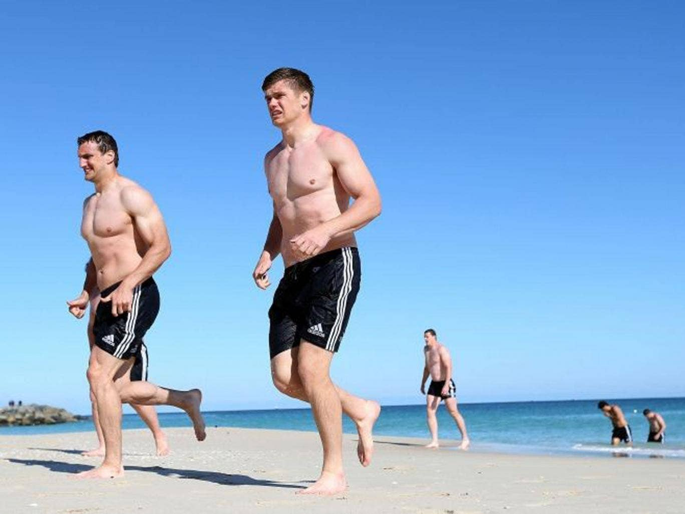 British and Irish Lions Owen Farrell and Sam Warburton (left) during a recovery session at City Beach, Perth in Australia (PA)