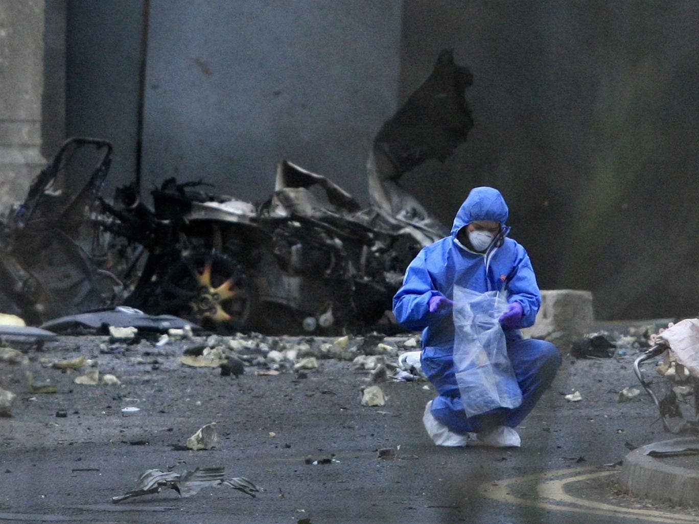A forensics officer outside Newry courthouse after a car bomb attack in February 2010 that was blamed on dissident republicans