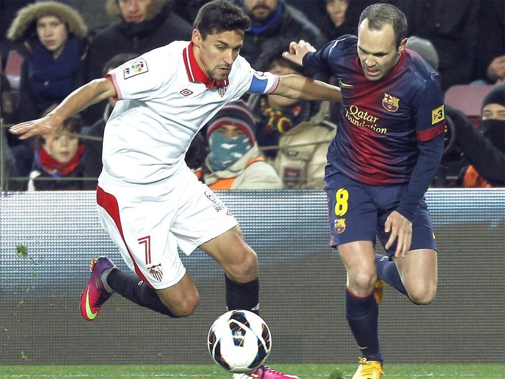 Jesus Navas takes on Andres Iniesta of Barcelona in his Sevilla days