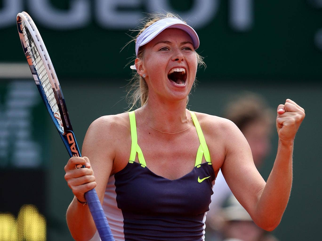 Maria Sharapova celebrates after reaching the semi-finals of the French Open