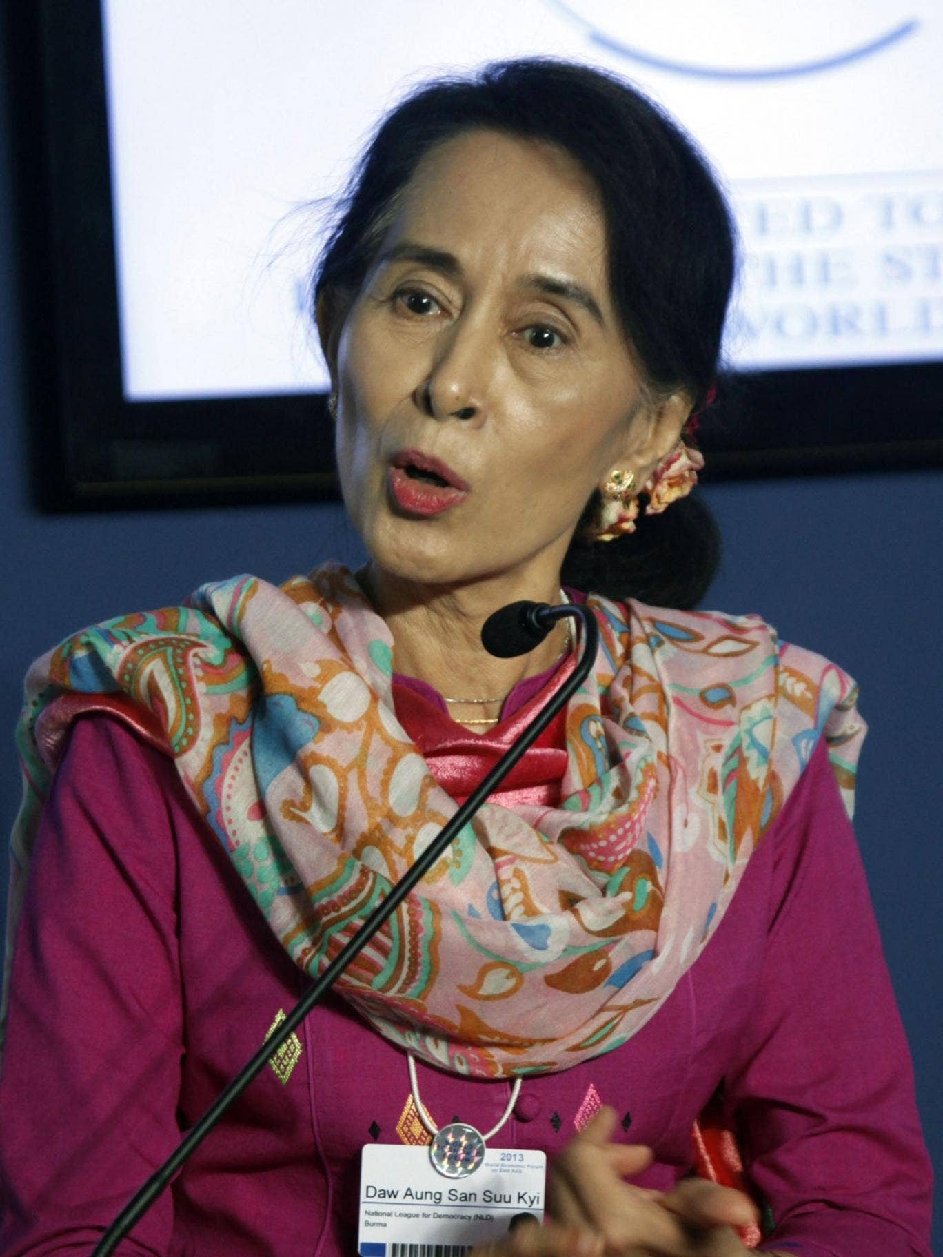 Myanmar's pro-democracy leader Aung San Suu Kyi talks to reporters during a news conference at the World Economic Forum