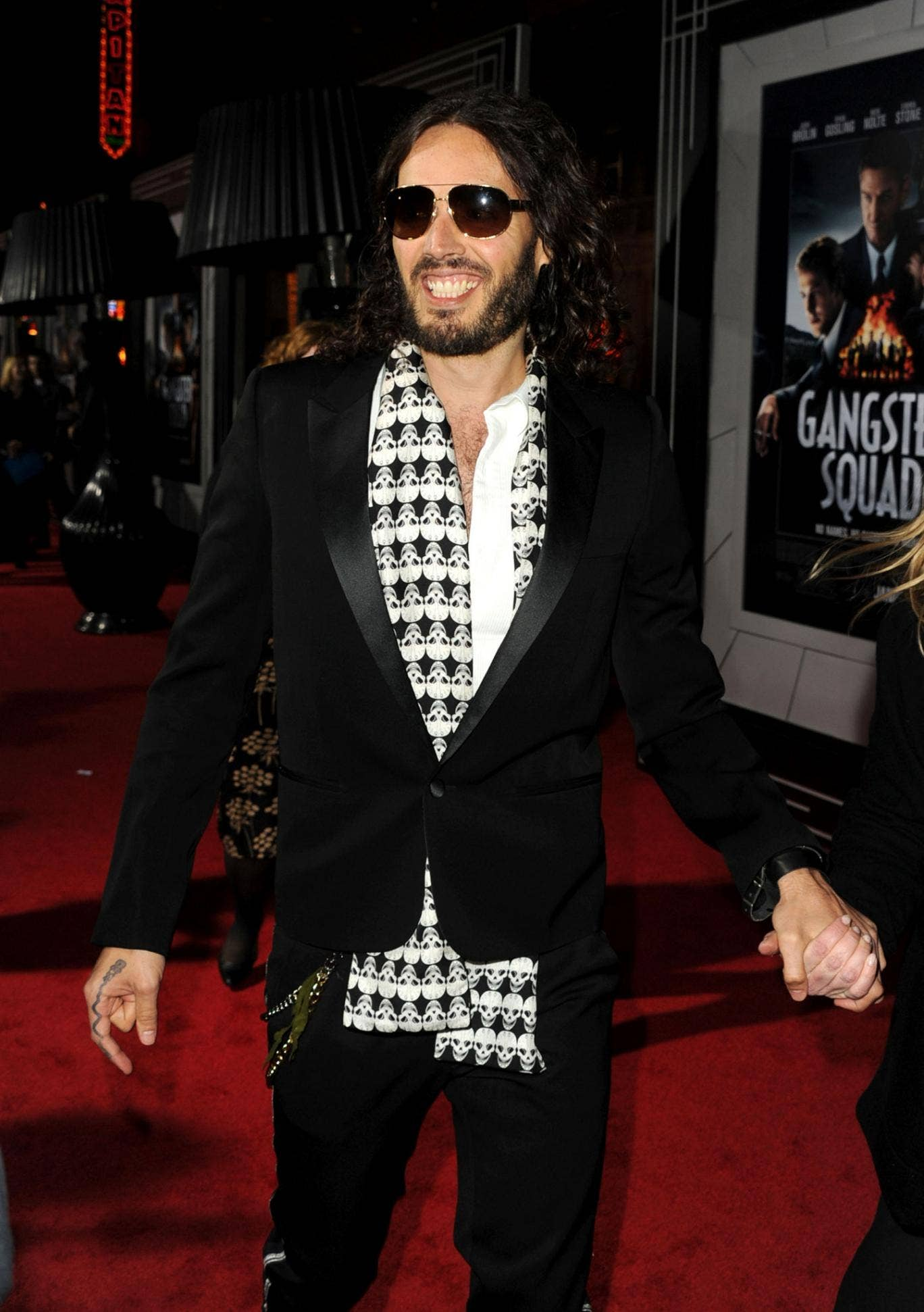 Russell Brand gives his best Doctor Who impression in a scarf and dark glasses at a recent film premiere.