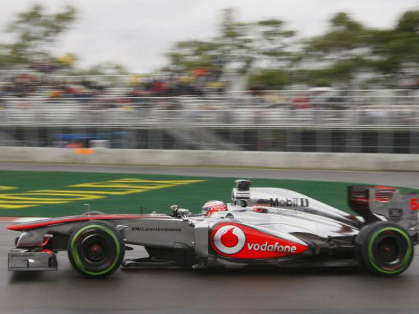 Jenson Button just trailed Paul di Resta, below, in yesterday's practice