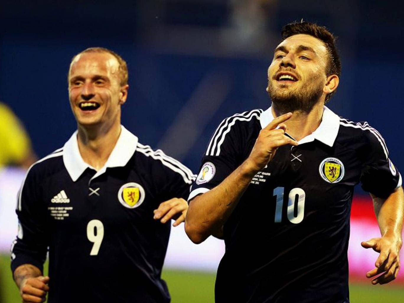 Scotland's Robert Snodgrass celebrates with his teammate Leigh Griffiths after scoring