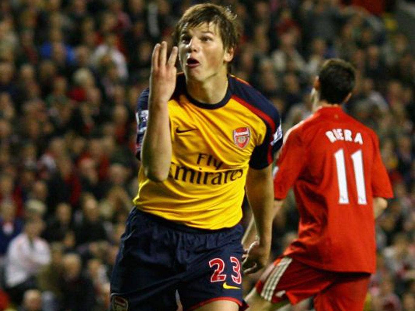 Arshavin celebrates the third of his four against Liverpool in 2009