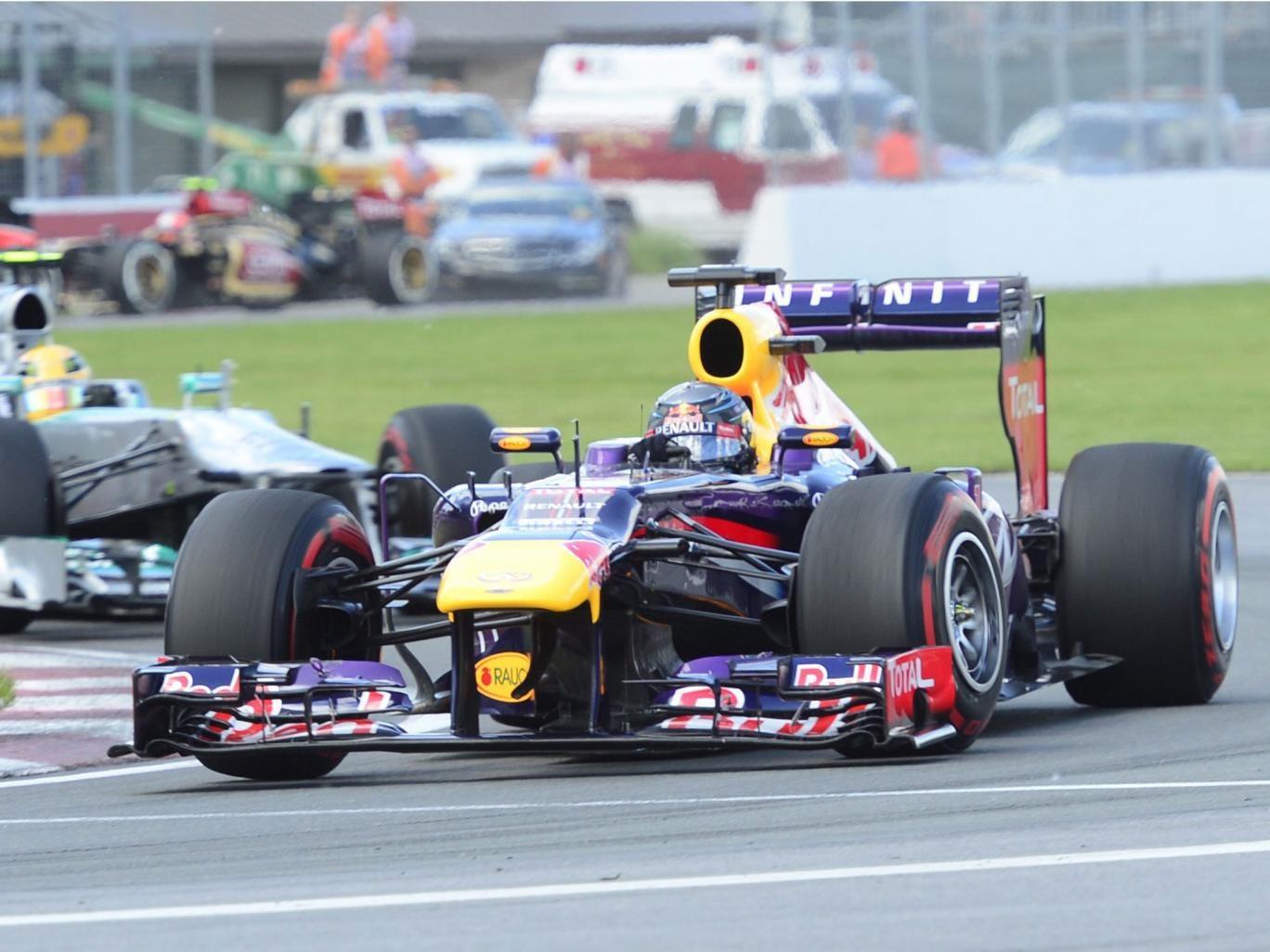 Red Bull's Sebastian Vettel leads Mercedes' Lewis Hamilton in Montreal