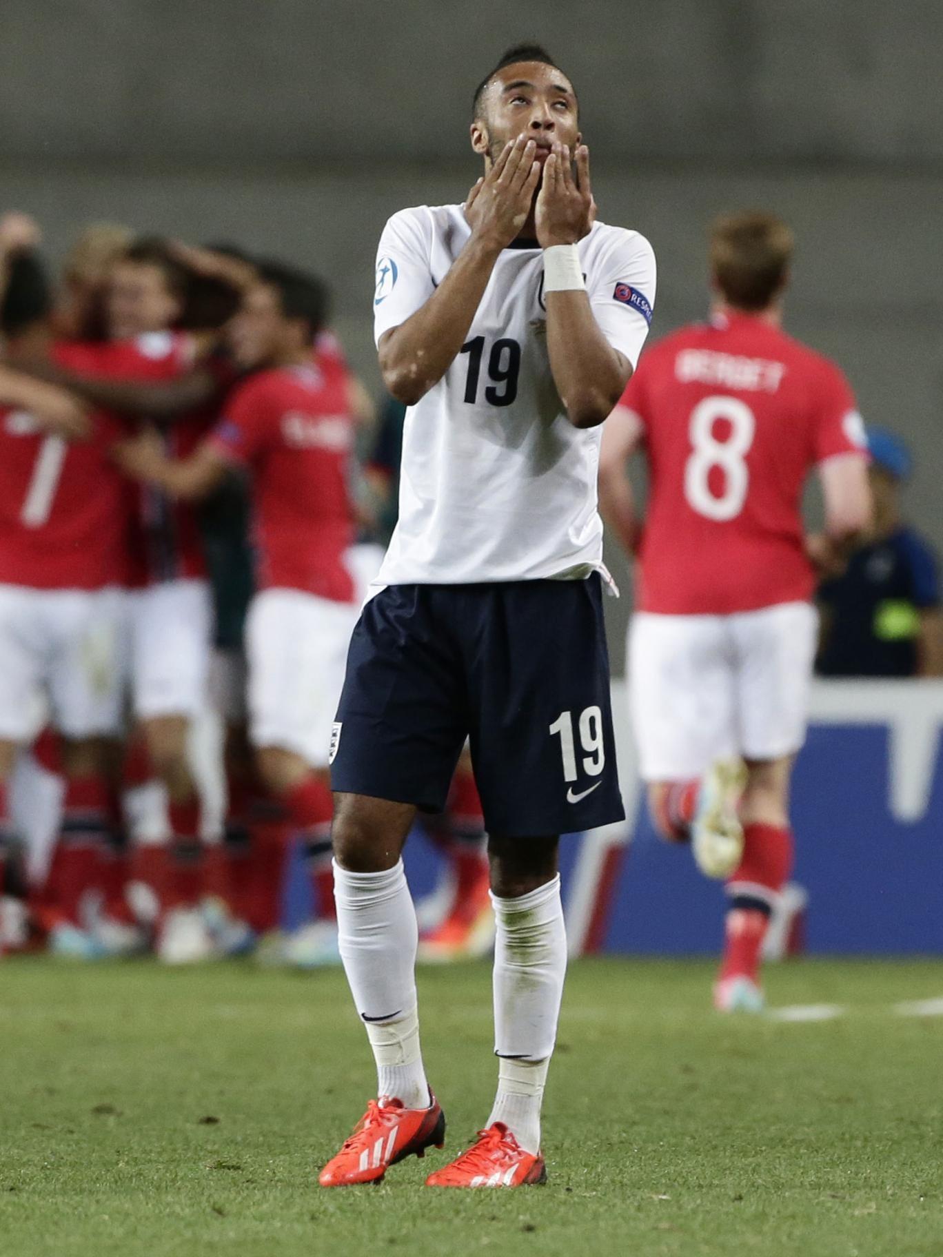 England's Nathan Redmond despairs as Norway celebrate their third goal