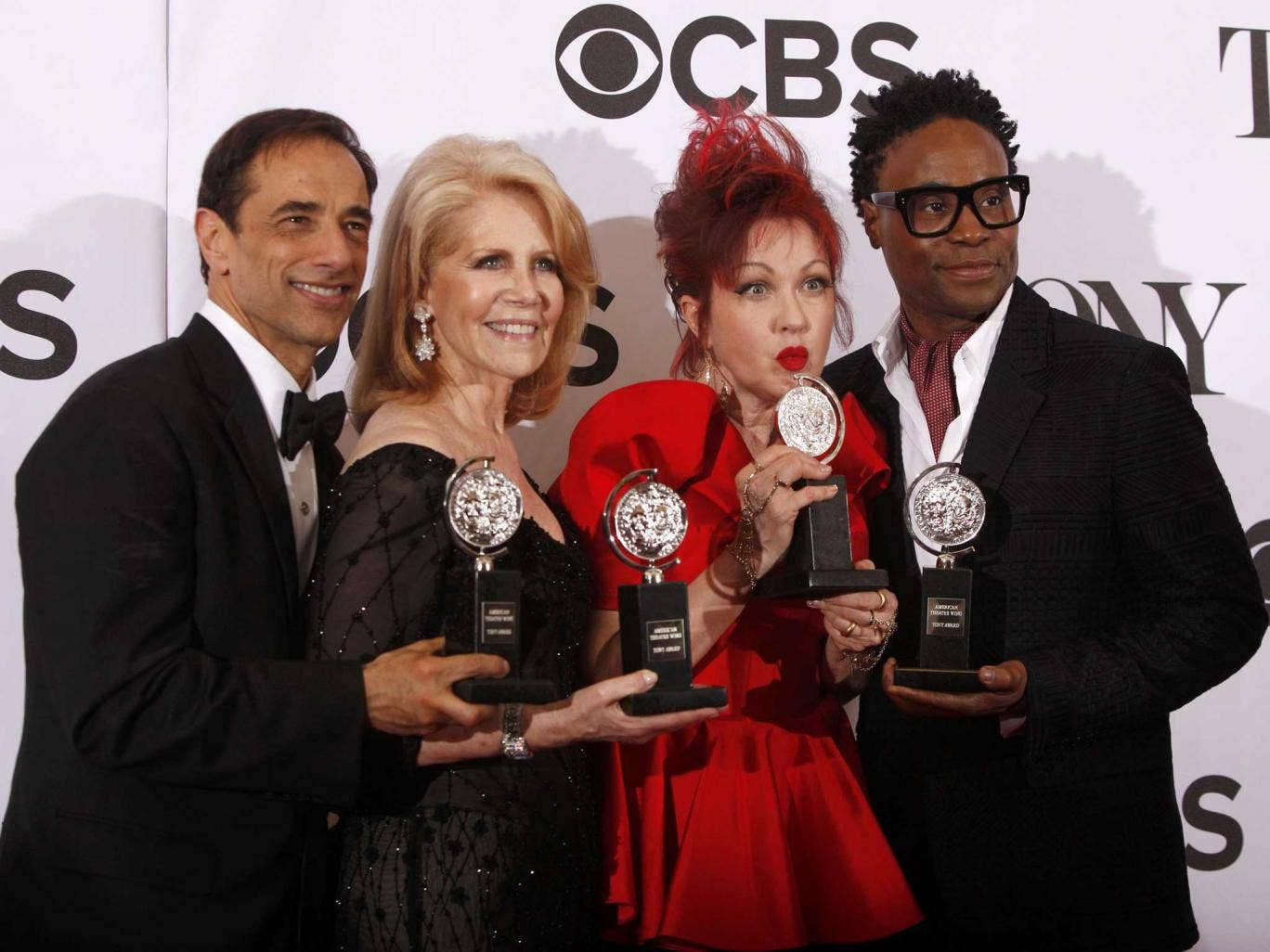 Producers Hal Luftig (L) and Daryl Roth join Cyndi Lauper and Billy Porter as they pose with their awards for Kinky Boots