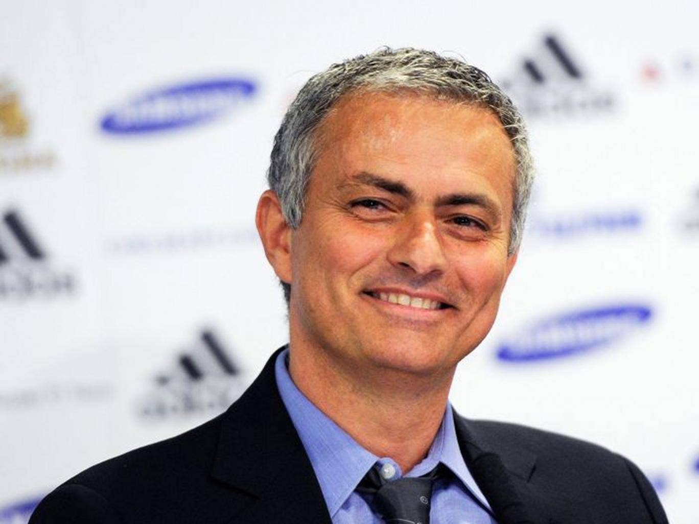 Jose Mourinho reacts with a smile during his first press conference as the new Chelsea manager at Stamford Bridge in London (EPA)