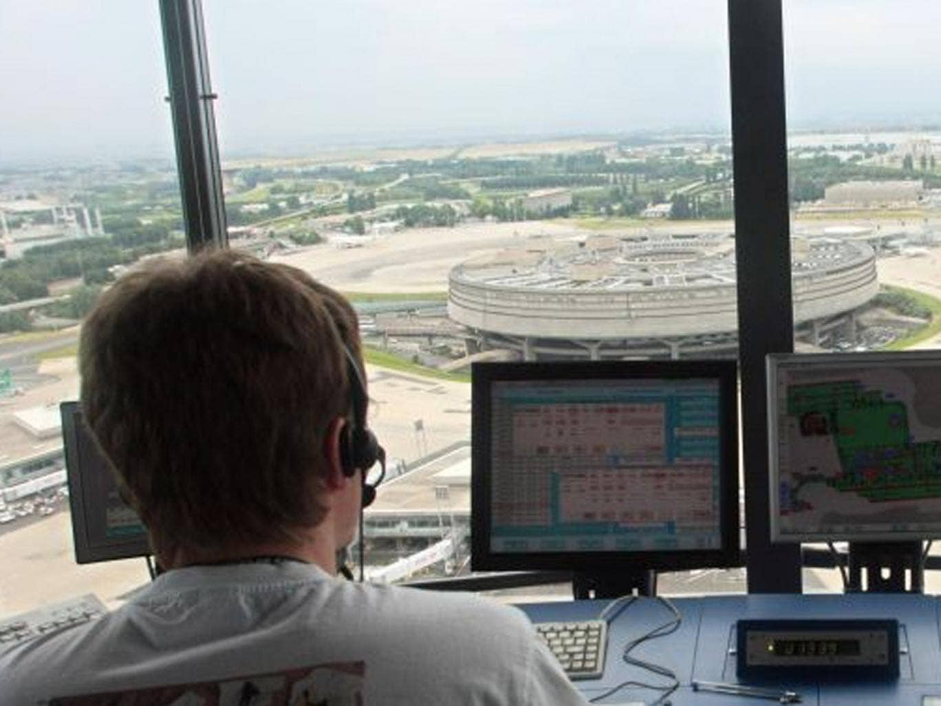 An air traffic controller at the Roissy Charles de Gaulle airport's control tower, in Roissy-en-France, northern Paris. Air traffic controllers plan three days of strikes beginning 11 June 2013