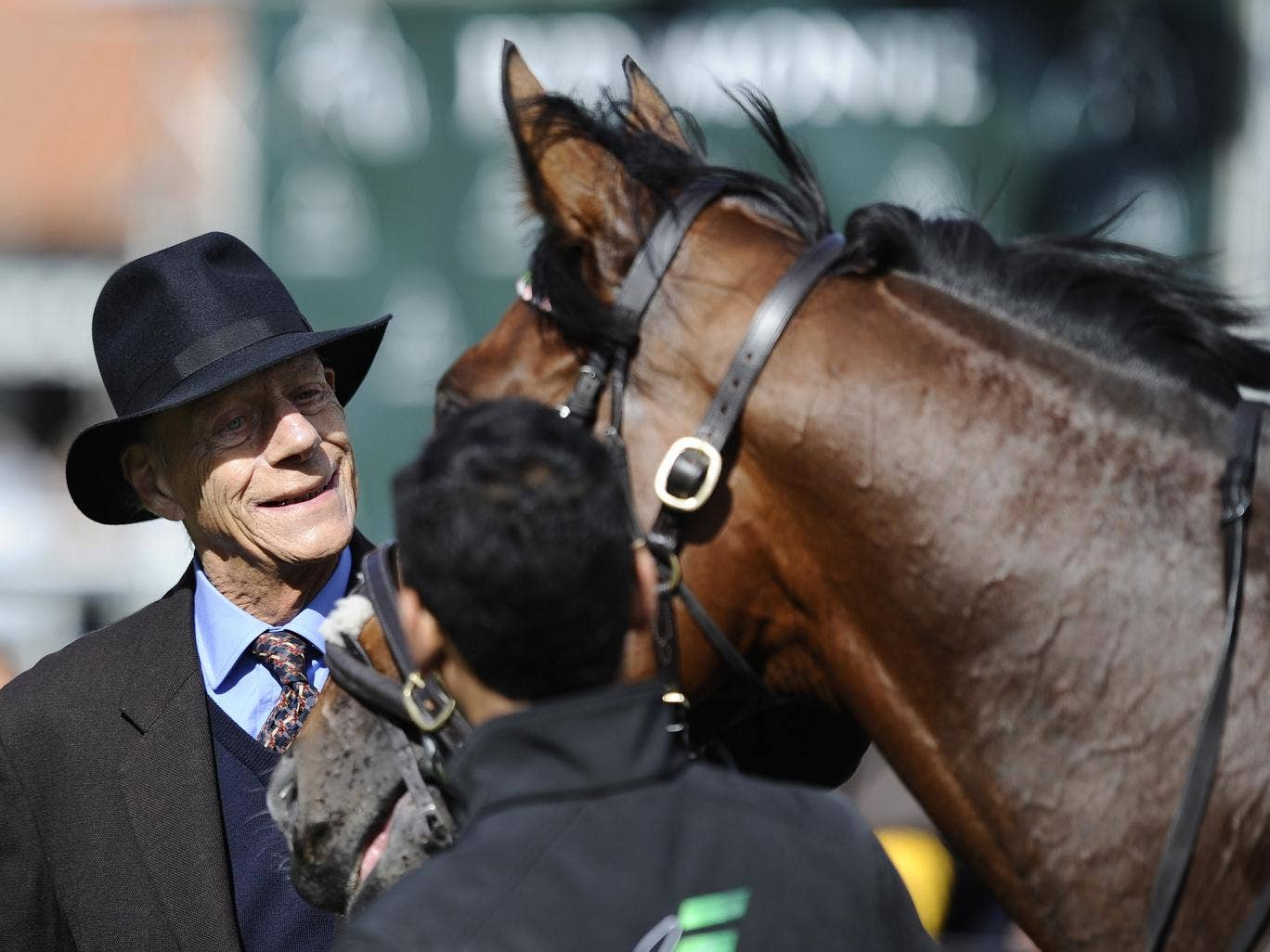 Sir Henry Cecil with Frankel at Newmarket racecourse on September 29, 2012