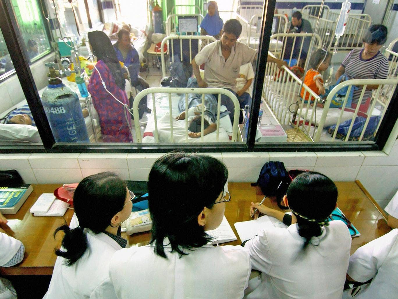 Doctors observe patients suffering from dengue fever during an outbreak of the virus in Jakarta, Indonesia, in 2005. The disease is common in Asia