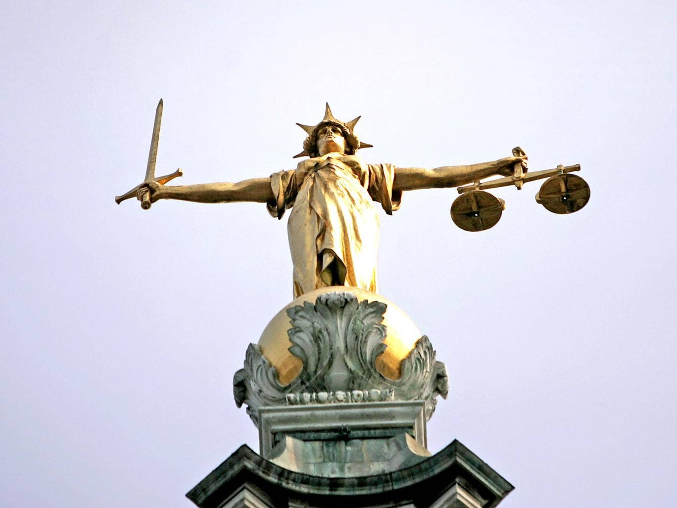 Scales of justice: the Ministry of Justice is pushing through a £220 million annual cut to the criminal legal aid bill