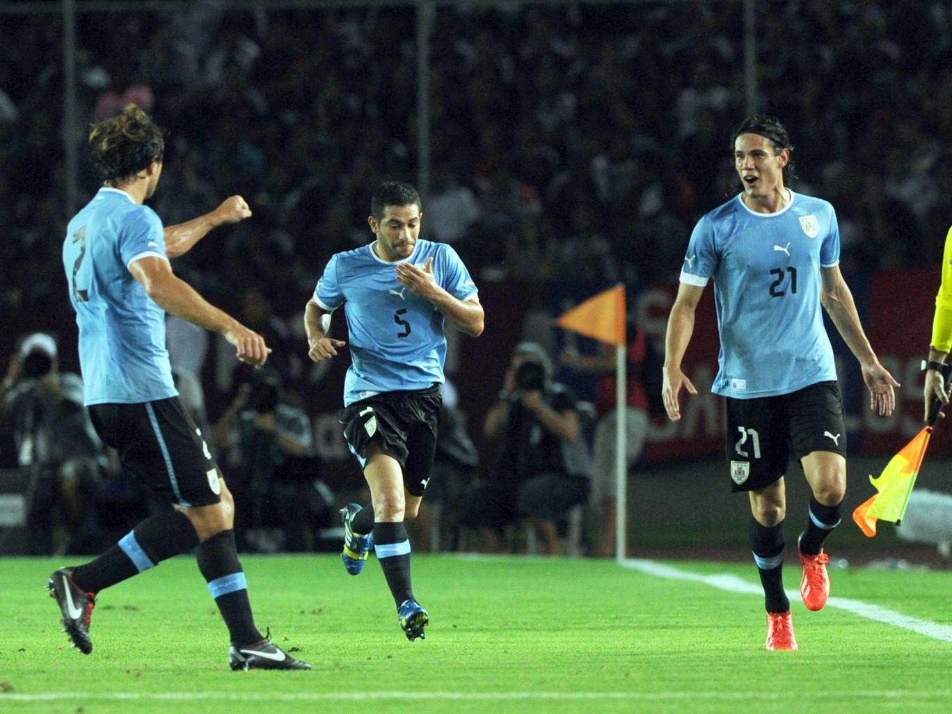 Edinson Cavani celebrates his goal for Uruguay against Venezuela in a World Cup qualifier
