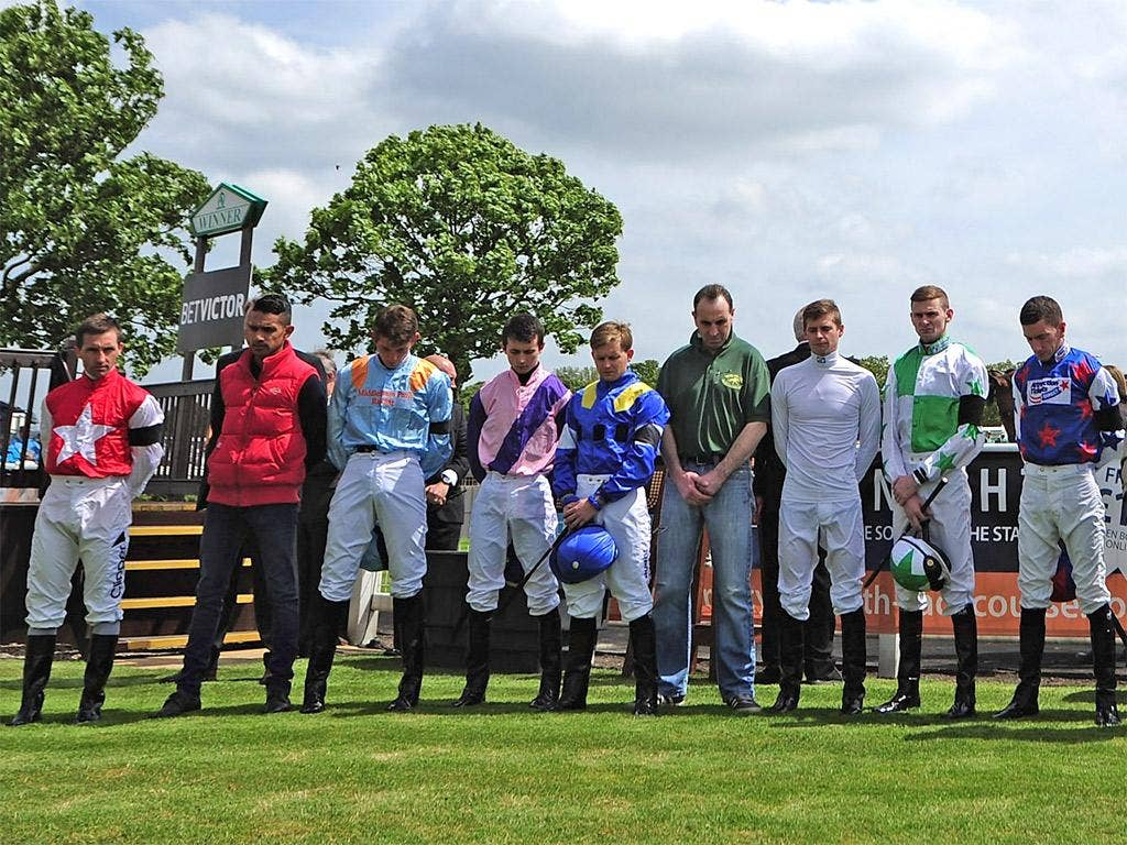 Jockeys at Great Yarmouth yesterday hold a minute's silence in memory of Sir Henry Ceci