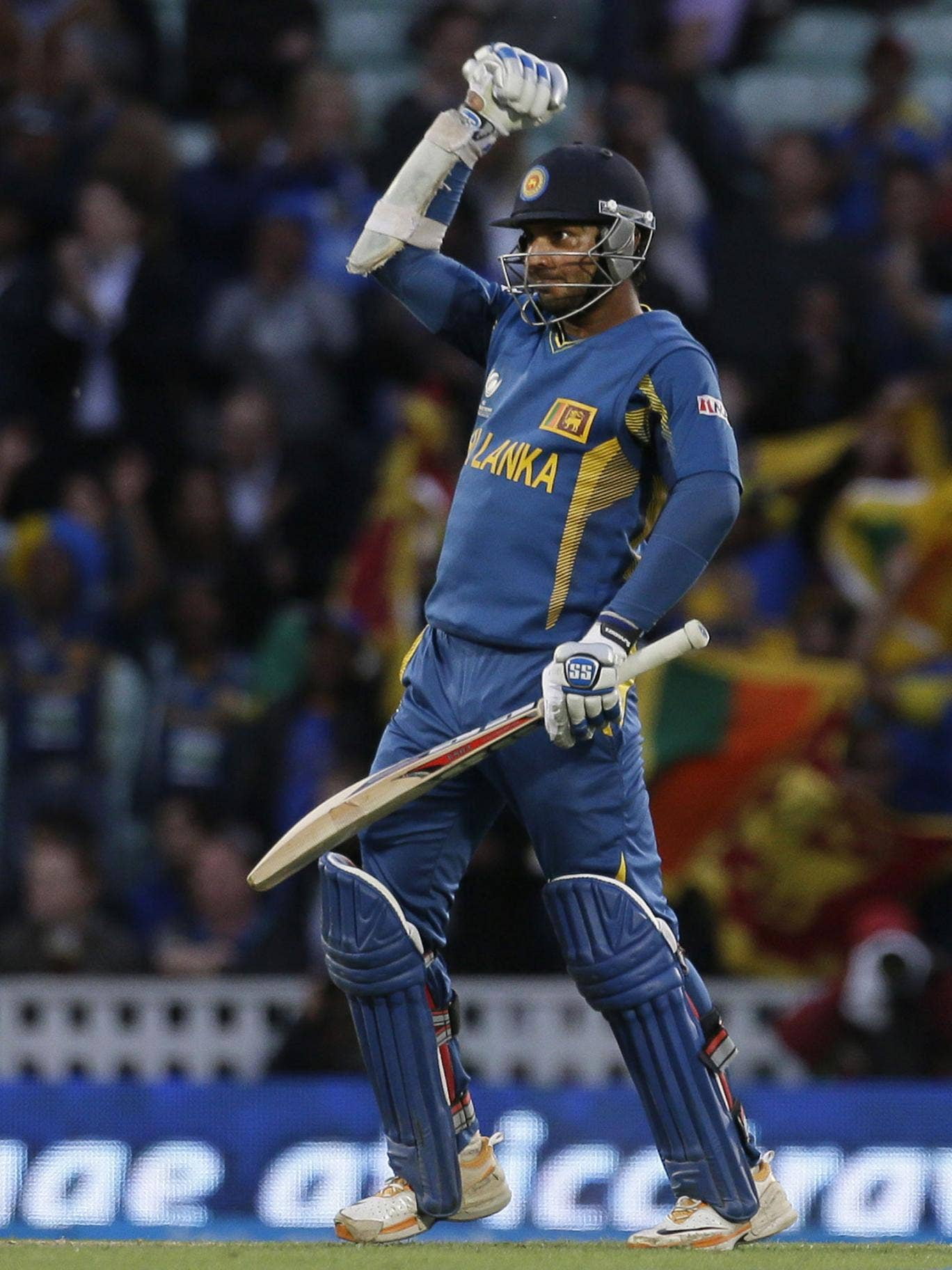 Sri Lanka's Kumar Sangakkara punches the air after he hit the winning runs to defeat England in their ICC Champions Trophy cricket match at the Oval cricket ground in London