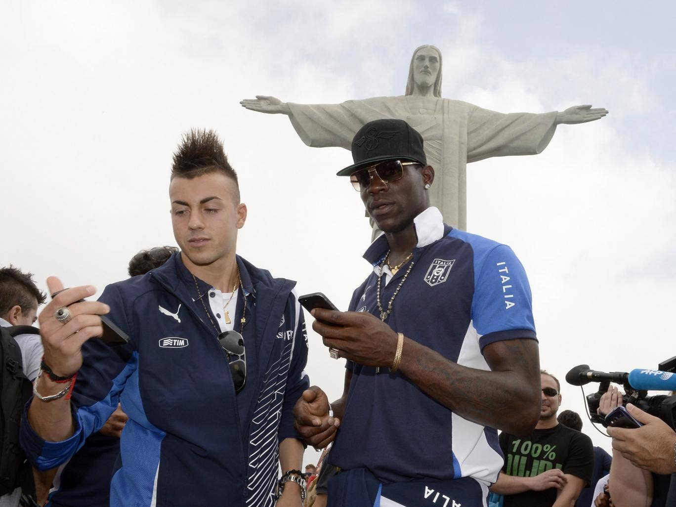 Stephan El Shaarawy and Mario Balotelli (R) of Italy visit the Christ the Redeemer Statue