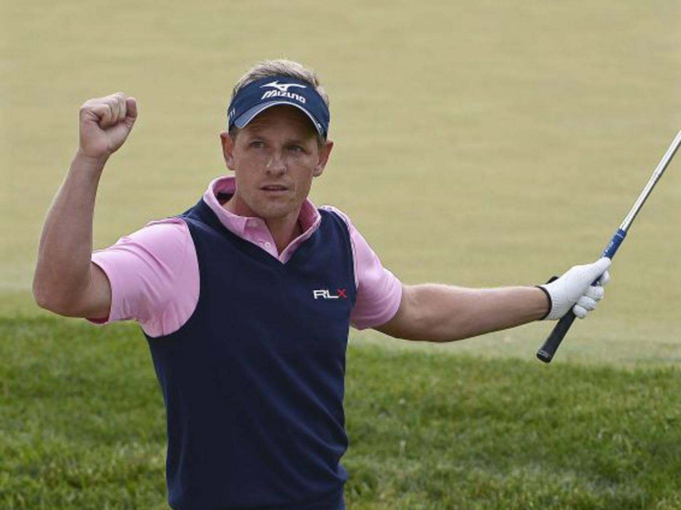 Luke Donald celebrates a birdie on the 13th during his second round