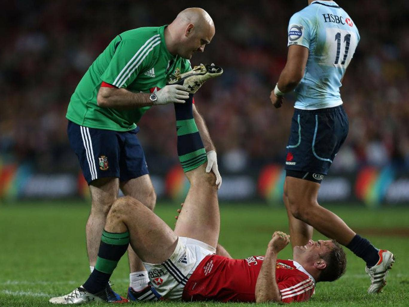 The Lions' Jamie Roberts looked in pain as he received treatment for an injury that could rule him out of the next match (David Davies/PA)