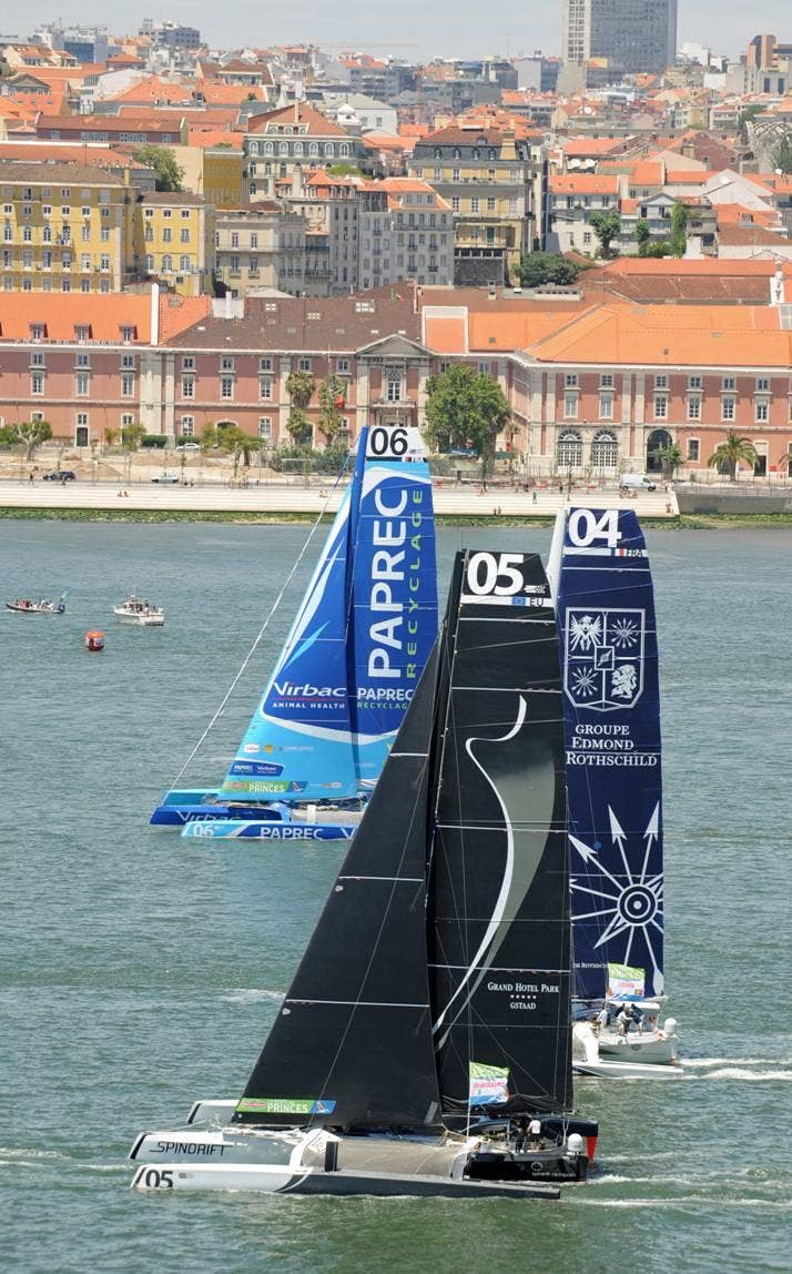 Yann Guichard's MOD70 Spindrift leads the charge out of Lisbon on the second leg of the Route des Princes to Dublin.